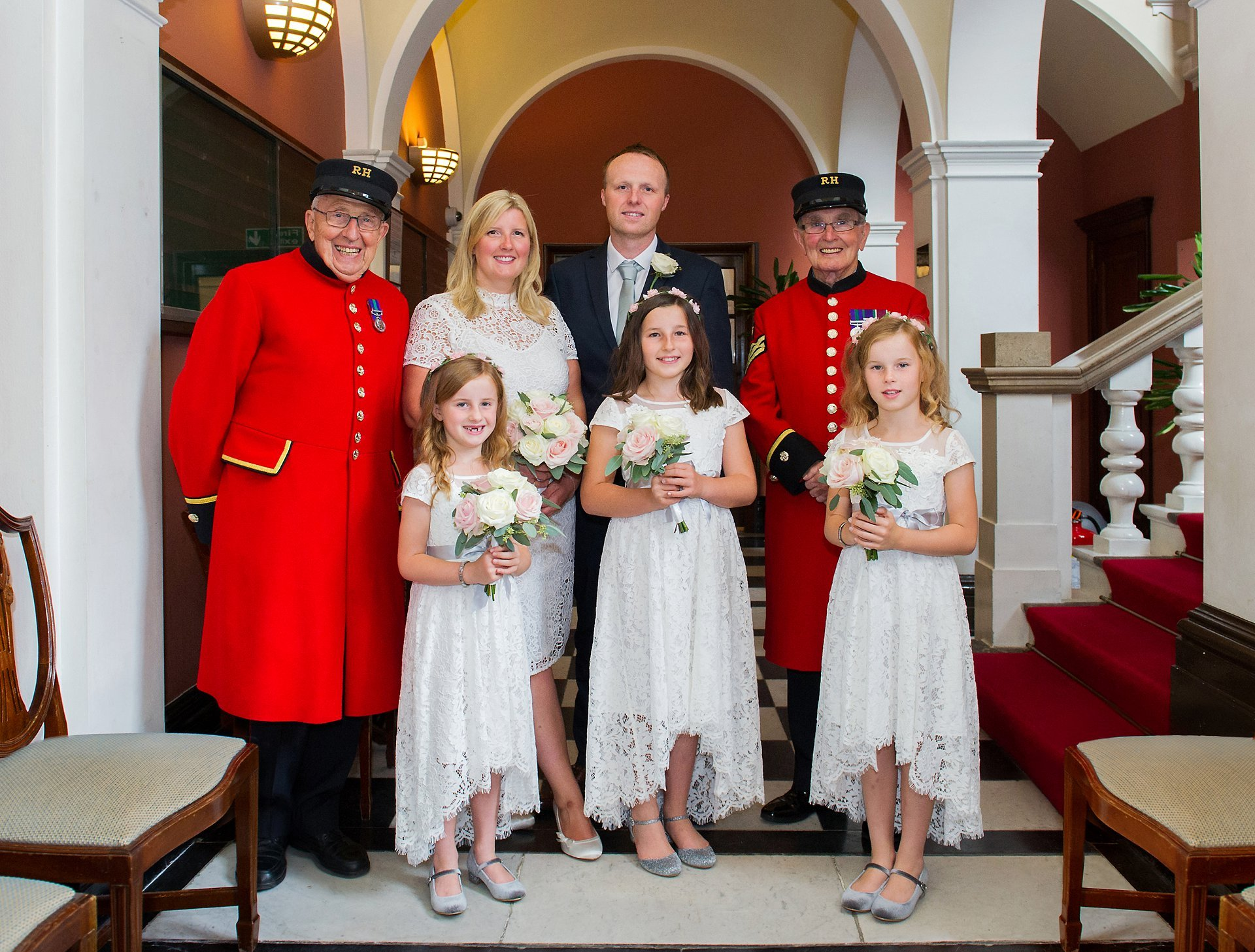 The couple, their three daughters and two Chelsea Pensioners in the waiting area at Chelsea Town Hall before their wedding ceremony