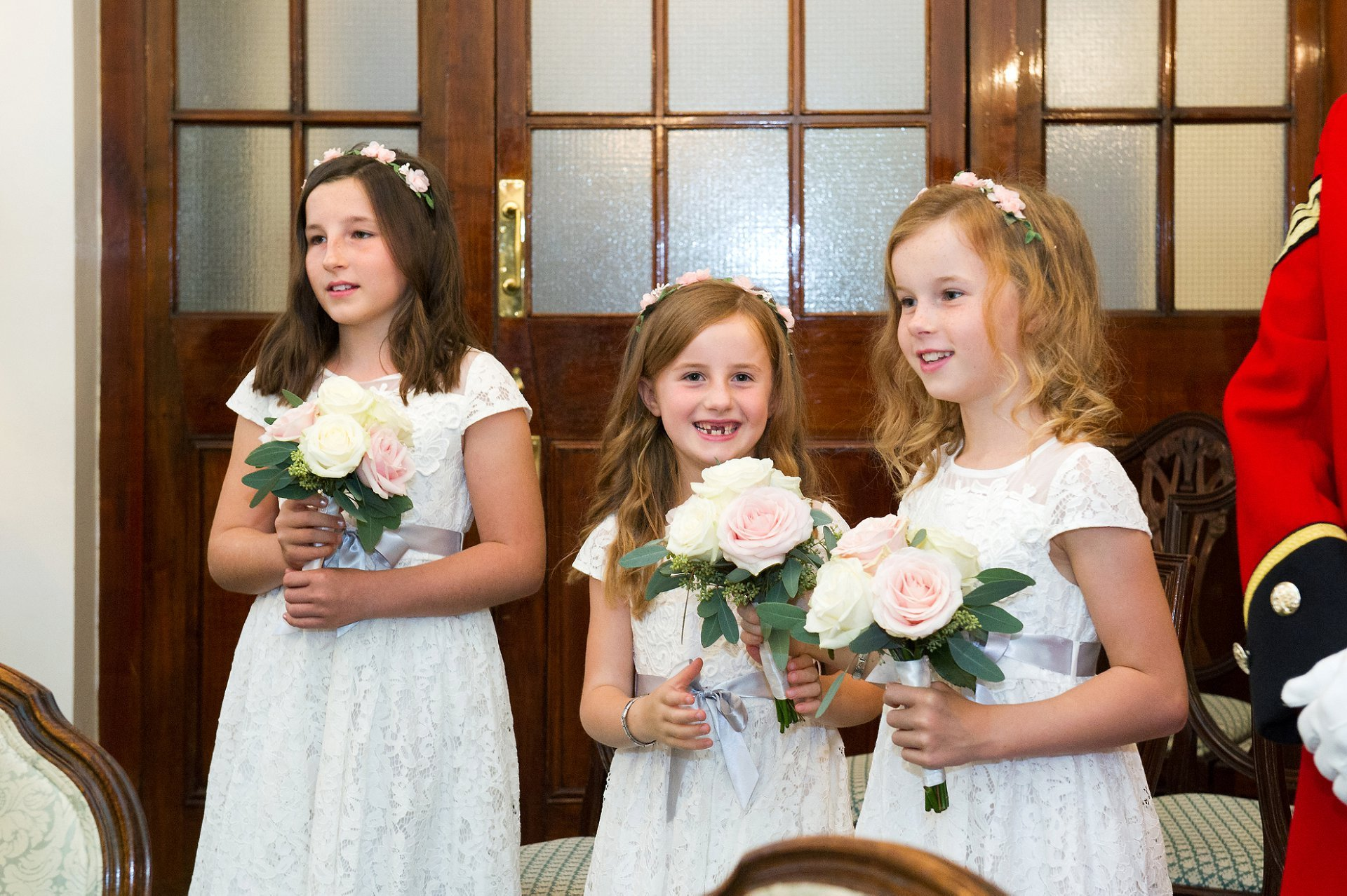 Three small flowergirls watch their parents marry in this family wedding at Chelsea Old Town Hall