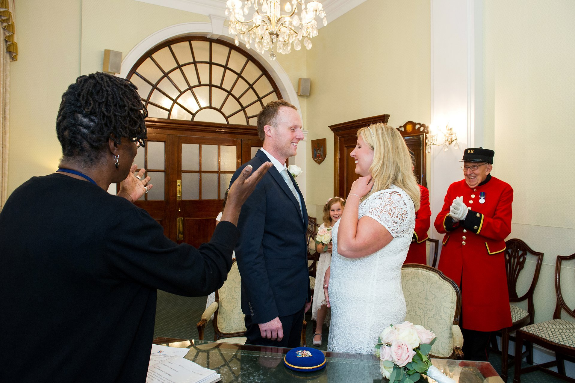 The Registrar congratulates the couple during this Chelsea Registry Office wedding