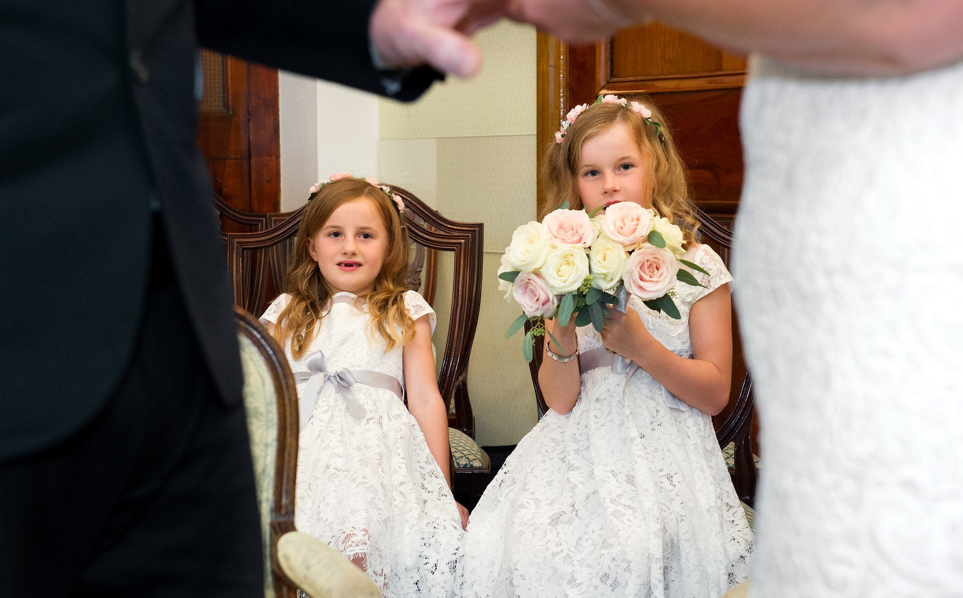 Daughters look on as their parents marry in the Rossetti Room at Chelsea Town Hall