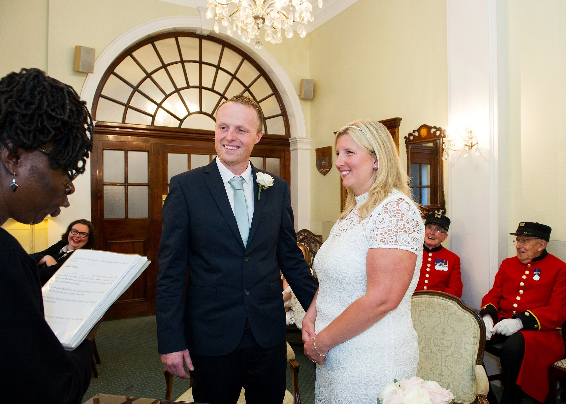 The Registrar from Kensington and Chelsea announces that Leah and Andrew are husband and wife during this amll family wedding at Chelsea Town Hall