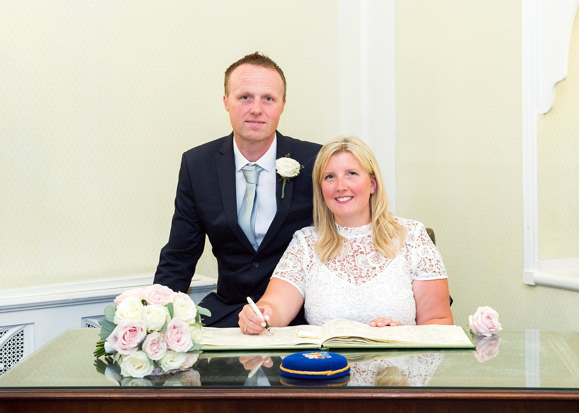 Andrew and Leah sign the register in the Rossetti Room at Chelsea Registry Office