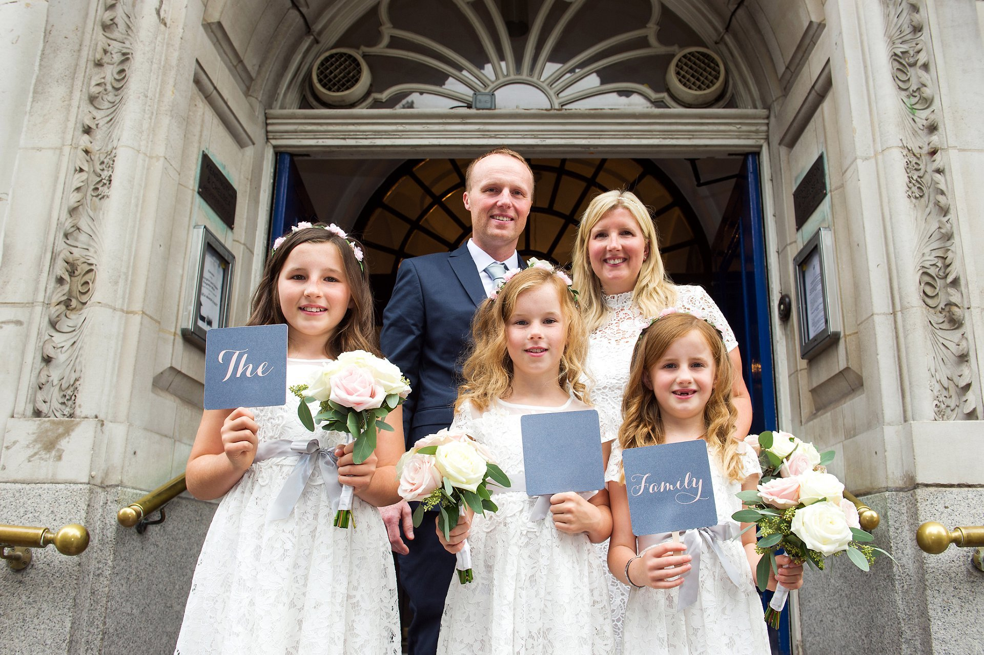 Family Wedding Photography Chelsea Town Hall and the couple with their three small daughters pose for a photo on the iconic Chelsea steps after their civil wedding (Emma Duggan Photography)