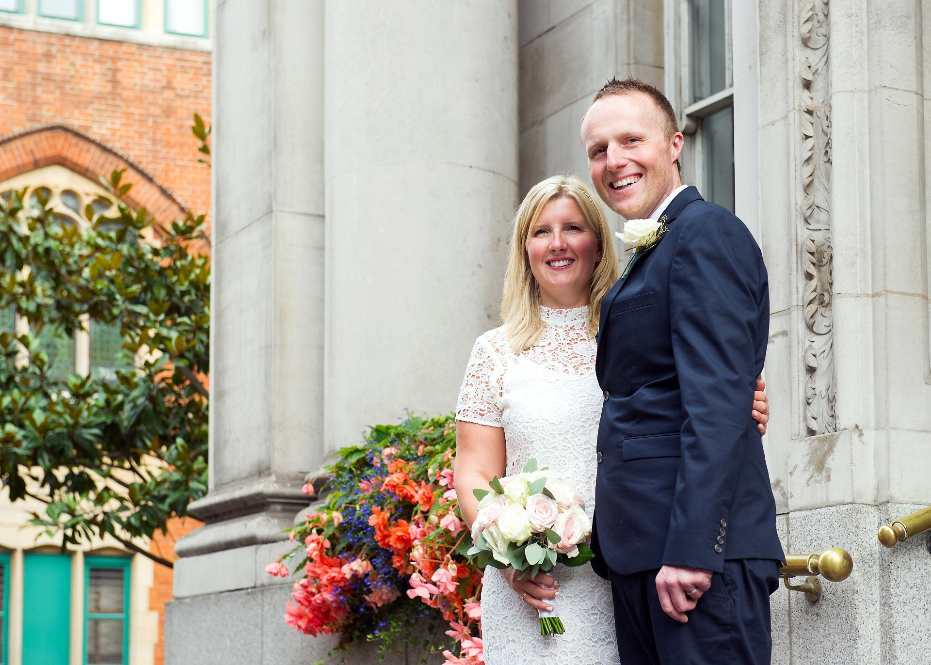 Bride and groom on the steps of Chelsea Registry Office