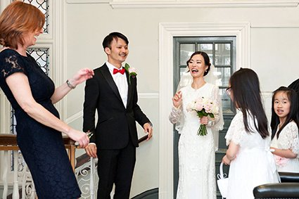 The bride laughs with the Registrar from Westminster Register Office