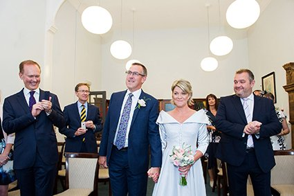 A bride and groom entering teh Marylebone Room at Mayfair Library (photo by Emma Duggan Photography)