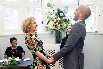 The groom shows his happiness during his civil marriage ceremony in the Marylebone Room at Mayfair Library