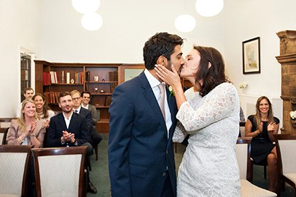 London register office wedding photogrpaher Emma Duggan captures a bride and groom's first kiss after their Mayfair Library wedding
