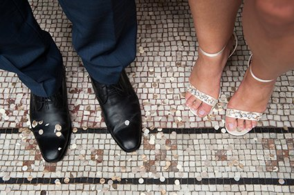 Bride and groom's feet after the confetti throw at Mayfair Library on South Audley Street
