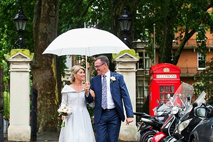 A bride and groom on South Audley Street in front of Mount Street Gardens after their Mayfair Library wedding ceremony in the Marylebone Room
