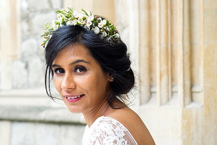 Old Marylebone Town Hall wedding photography by Emma Duggan - a London wedding photography expert - here showing a bride with natural flower headband and lace dress