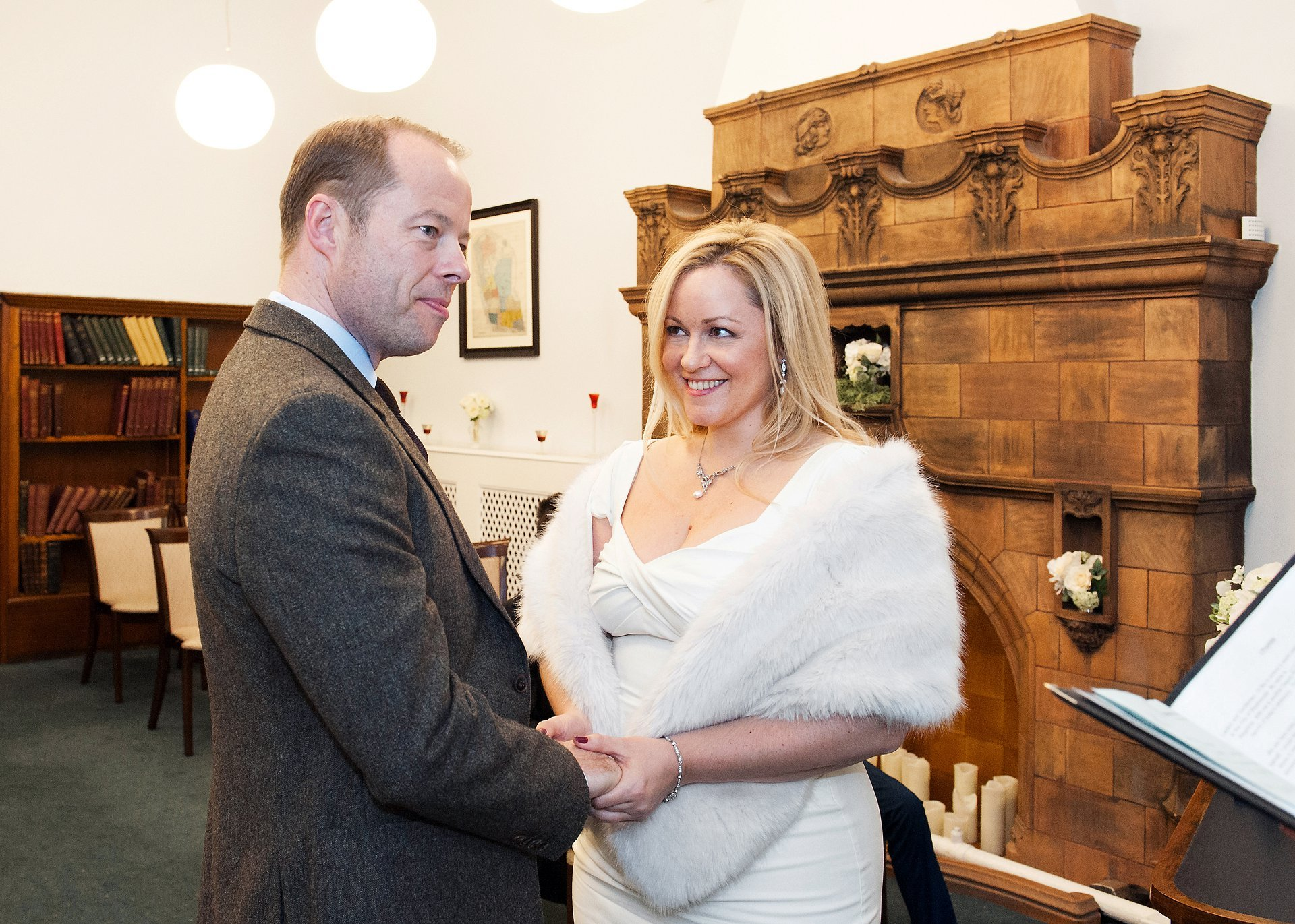 Westminster Register Office Christmas wedding in the Marylebone Room photographed by Westminster specialist Emma Duggan her showing a bride and groom exchanging vows during their civil ceremony