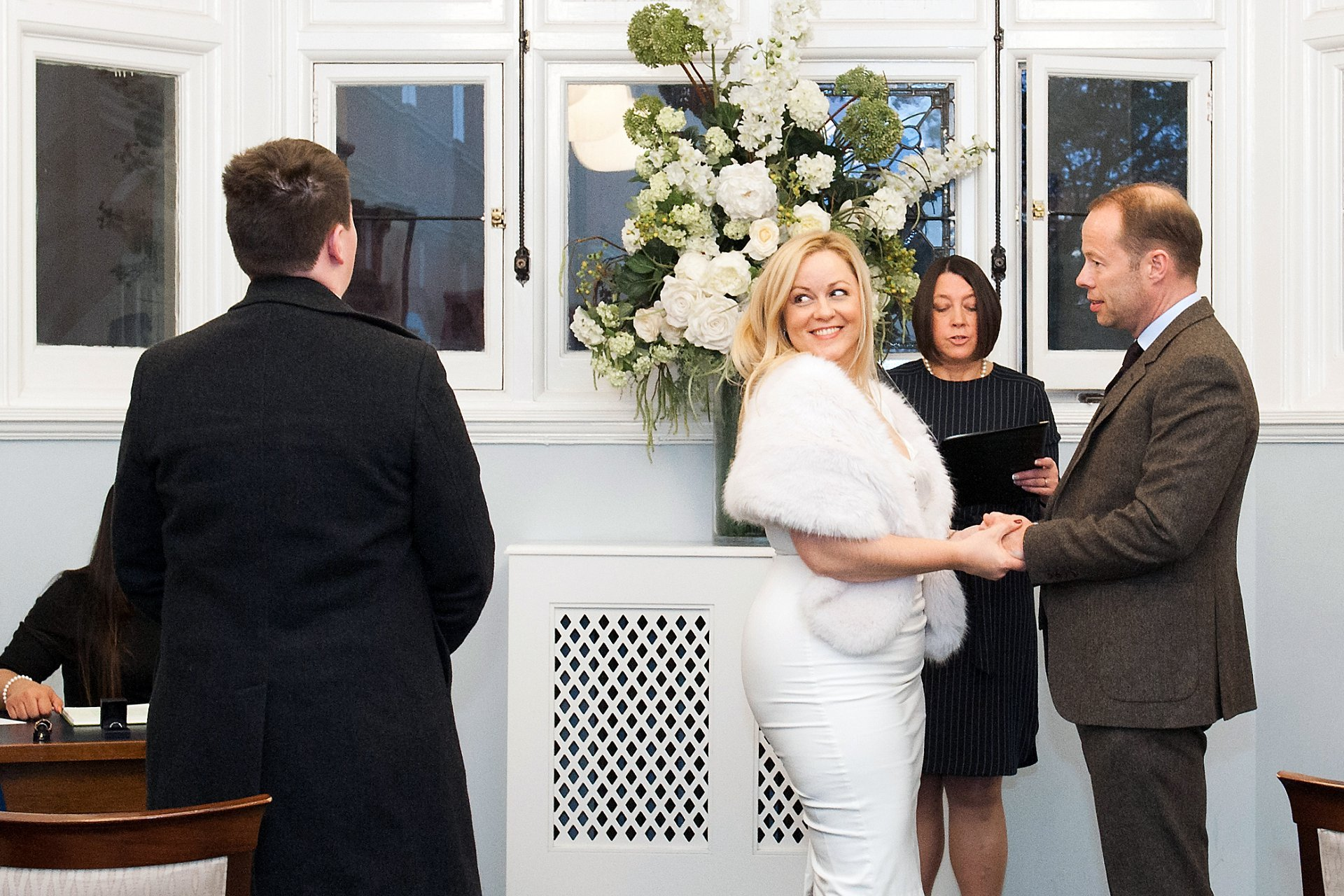 The bride looks at her step son during this Marylebone Room ceremony at Mayfair Library