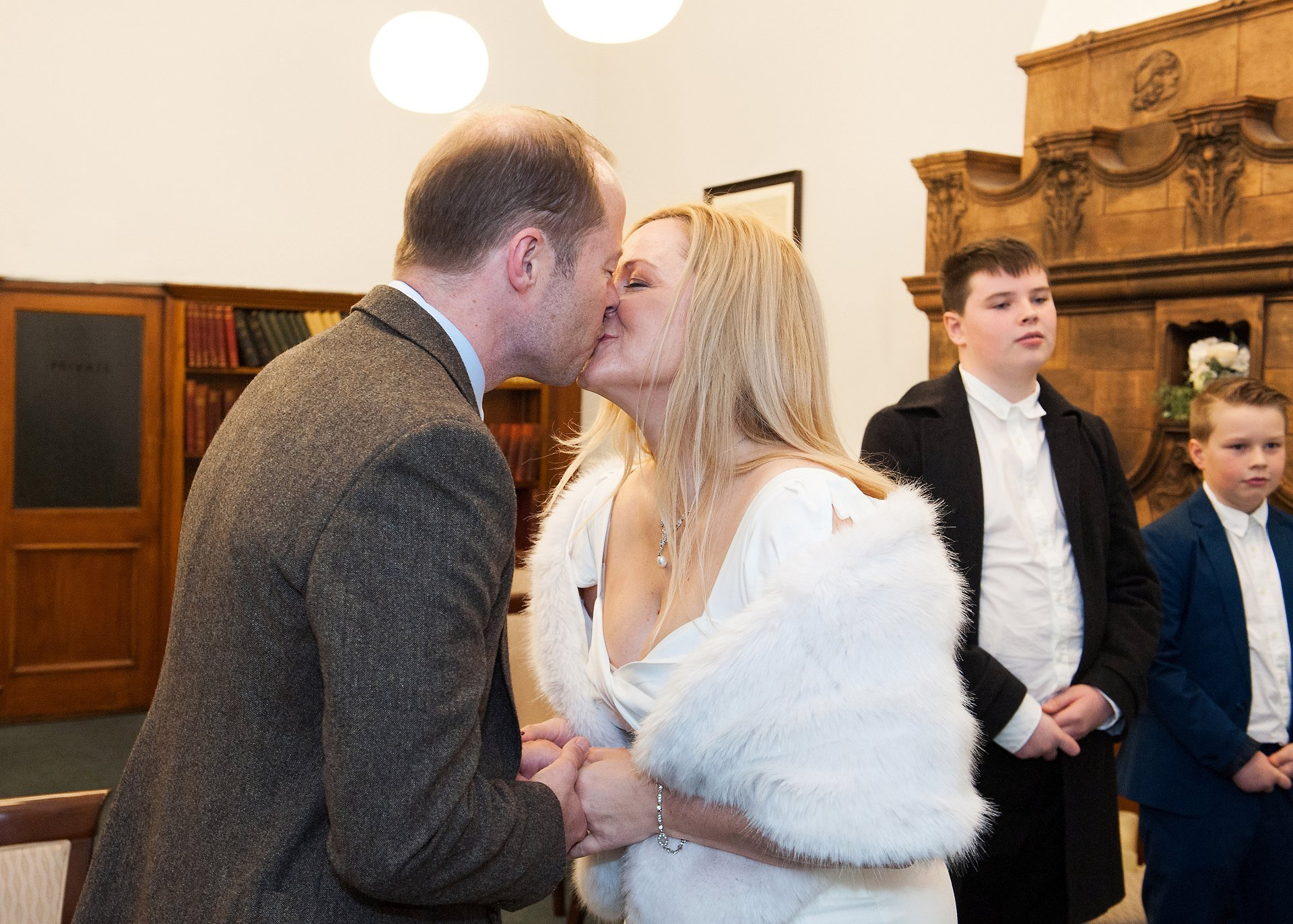 Mayfair Library wedding photographer - hourly coverage for small register office weddings at Westminster Register Office. Here a bride and groom kiss during their Marylebone Room civil wedding ceremony at Mayfair Library