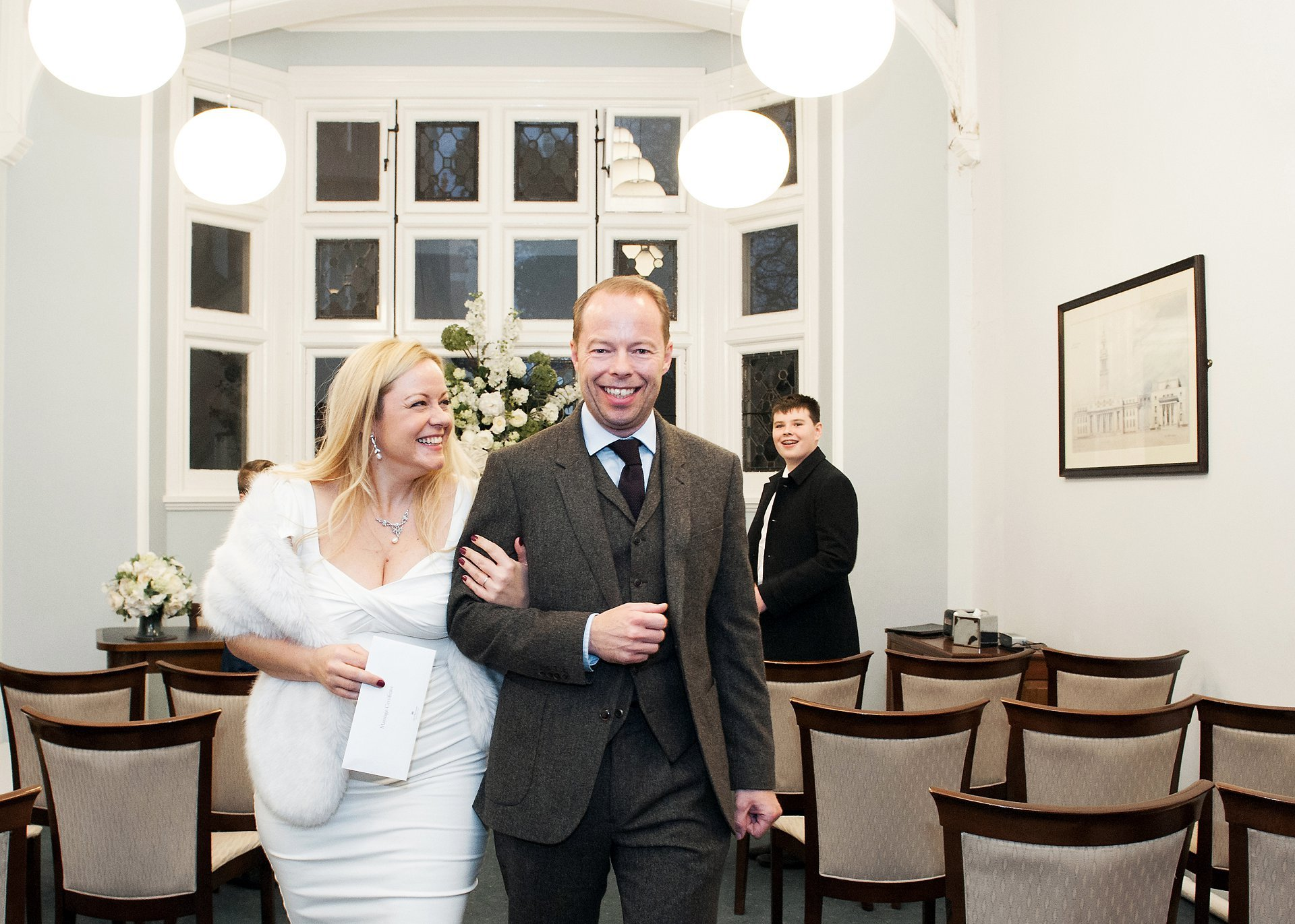 Westminster Register Office Christmas wedding in Mayfair Library's Marylebone Room with just two guests present and the photographer being one of the witnesses, along with the librarian