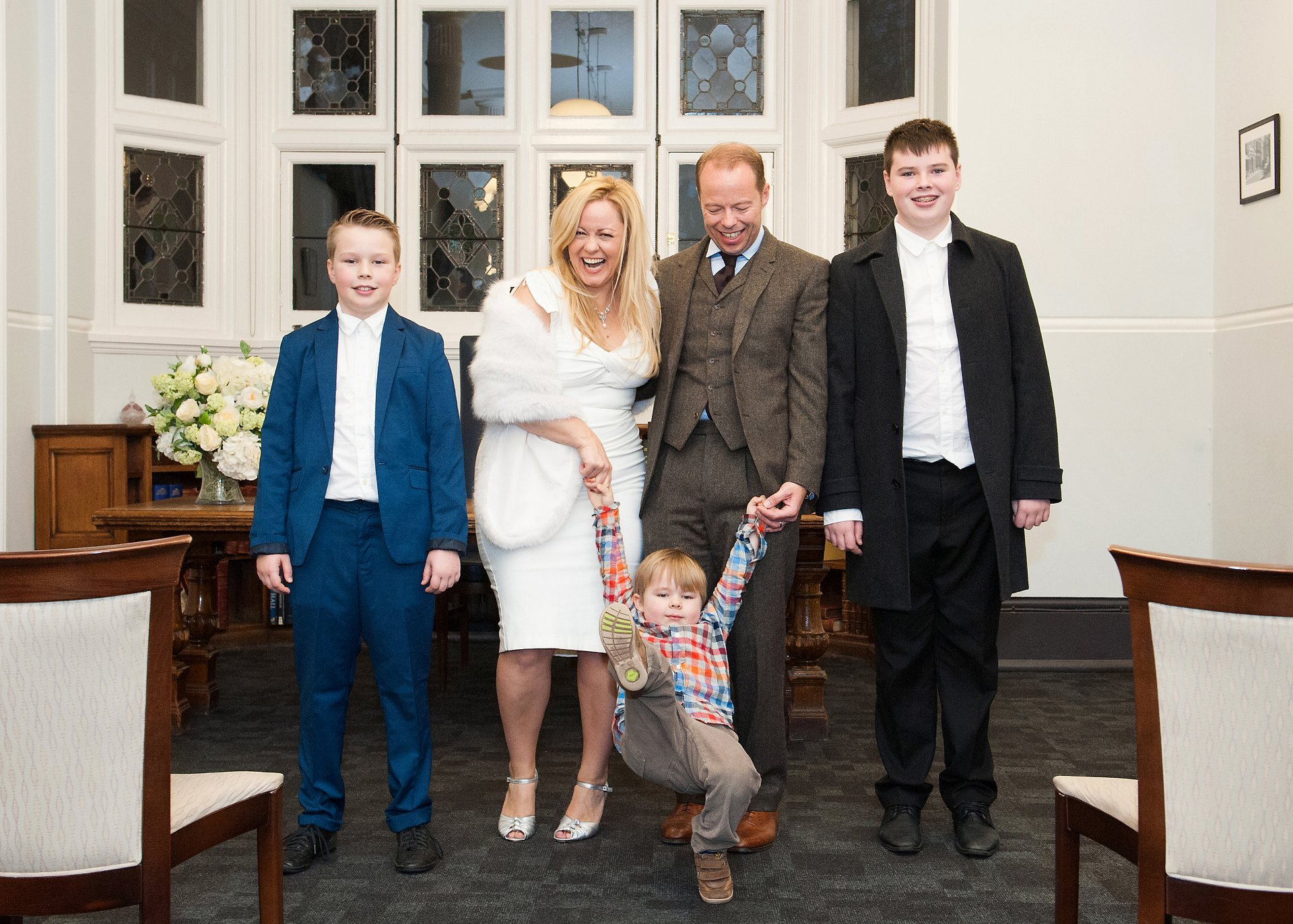 A family photograph after their civil marriage ceremony at Mayfair Library