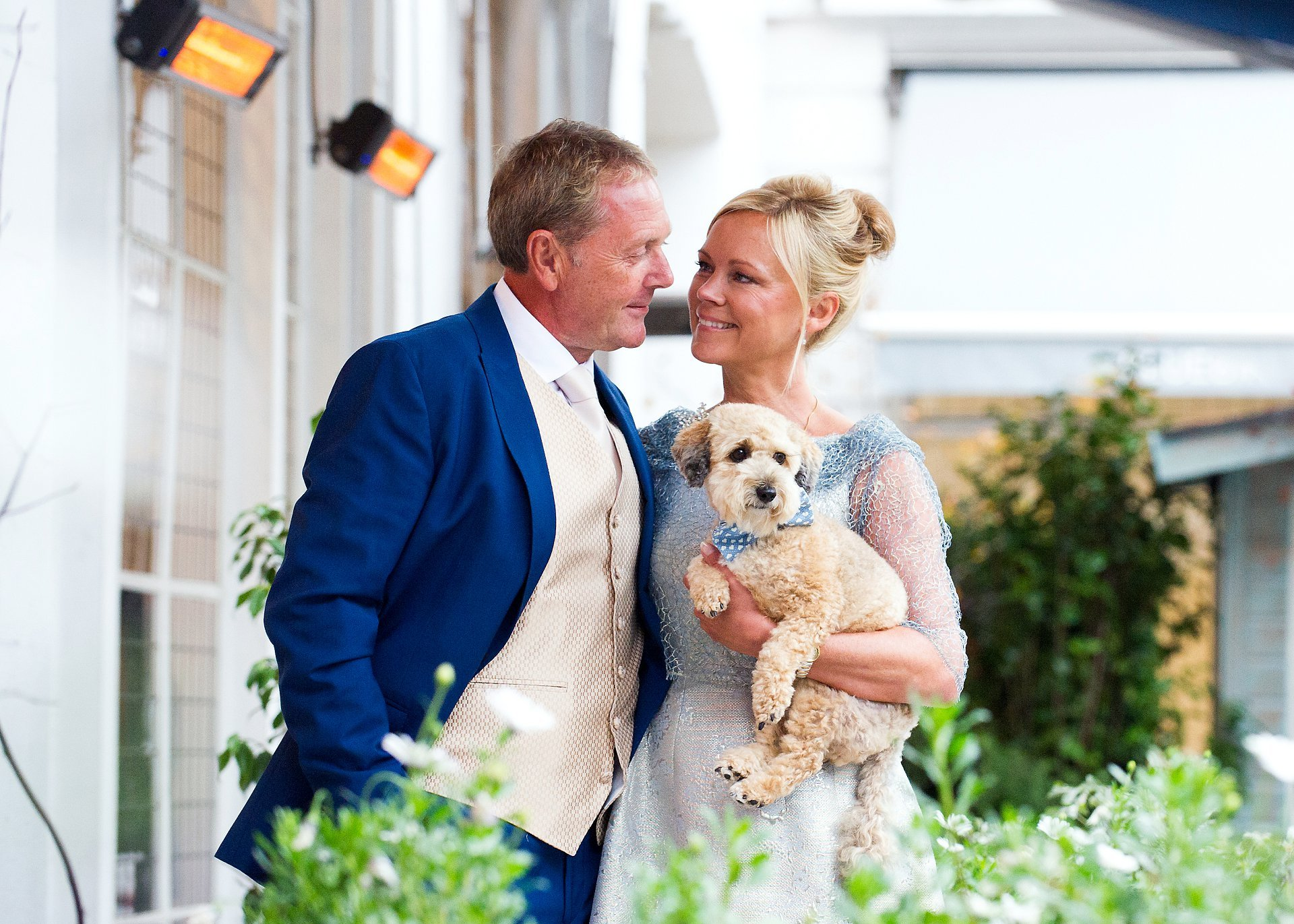 bluebird chelsea wedding reception showing a bride and groom with their little dog