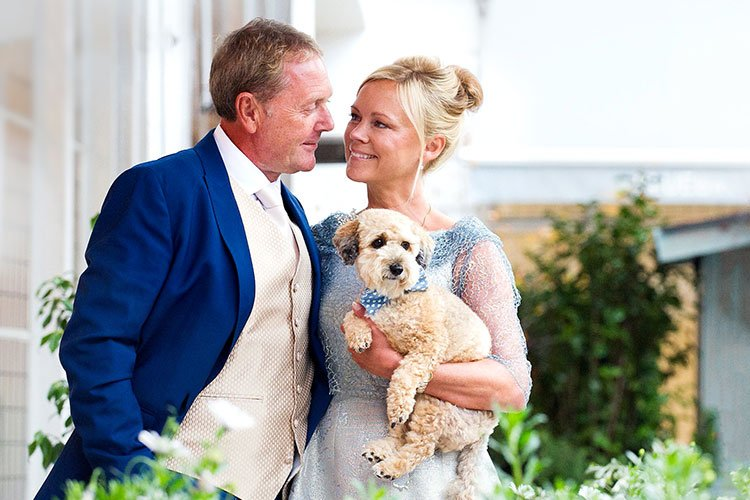 Wedding photo of couple who got married and wanted their dog in their wedding portraits. The dog was not allowed in the civil ceremony at Chelsea Old Town Hall, London.