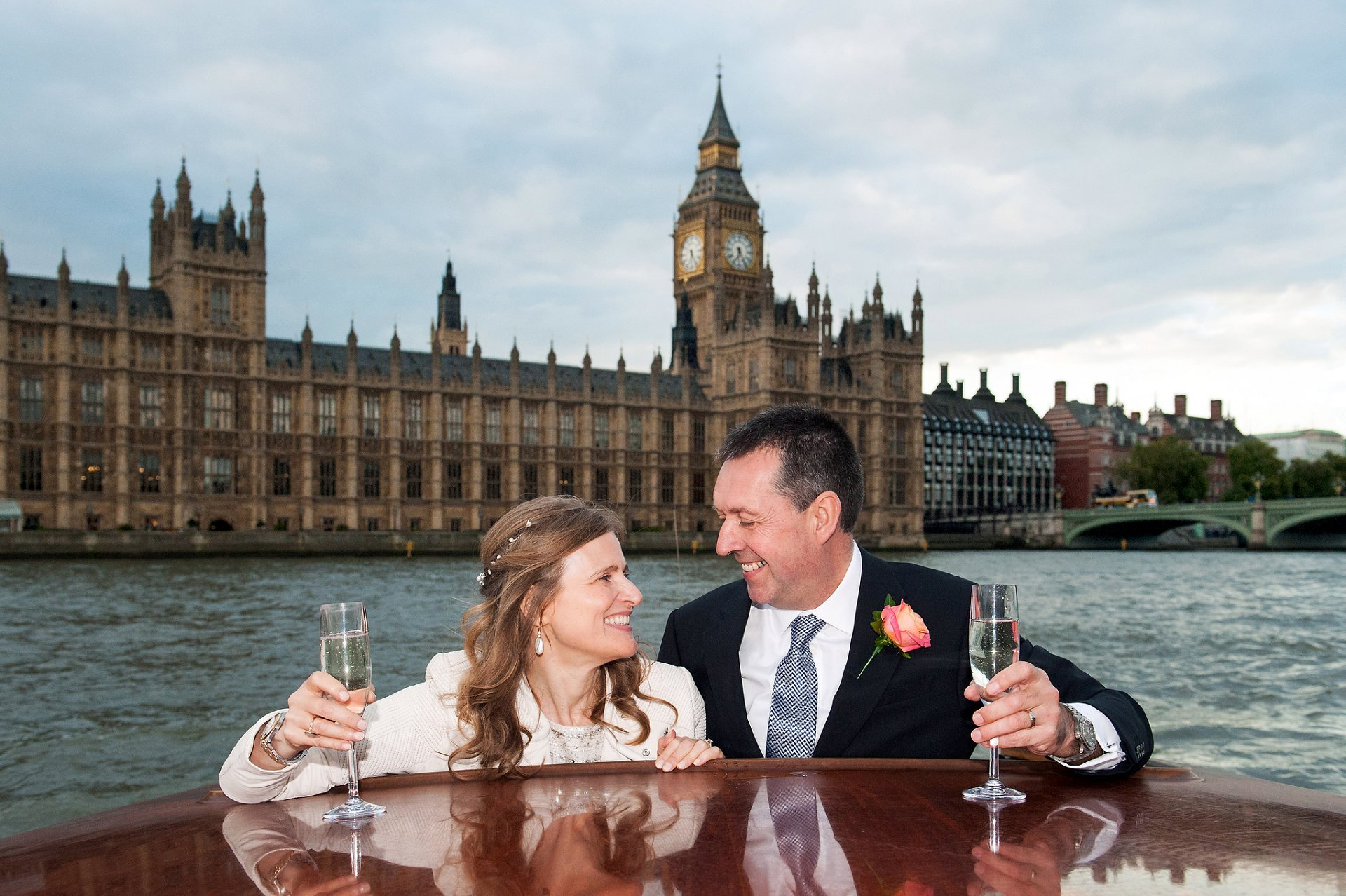 couple-champagne-wedding-day-luxury-romantic-cruise-thames-limo-bespoke-london-charter-houses-of-parliament-big-ben-emma-duggan
