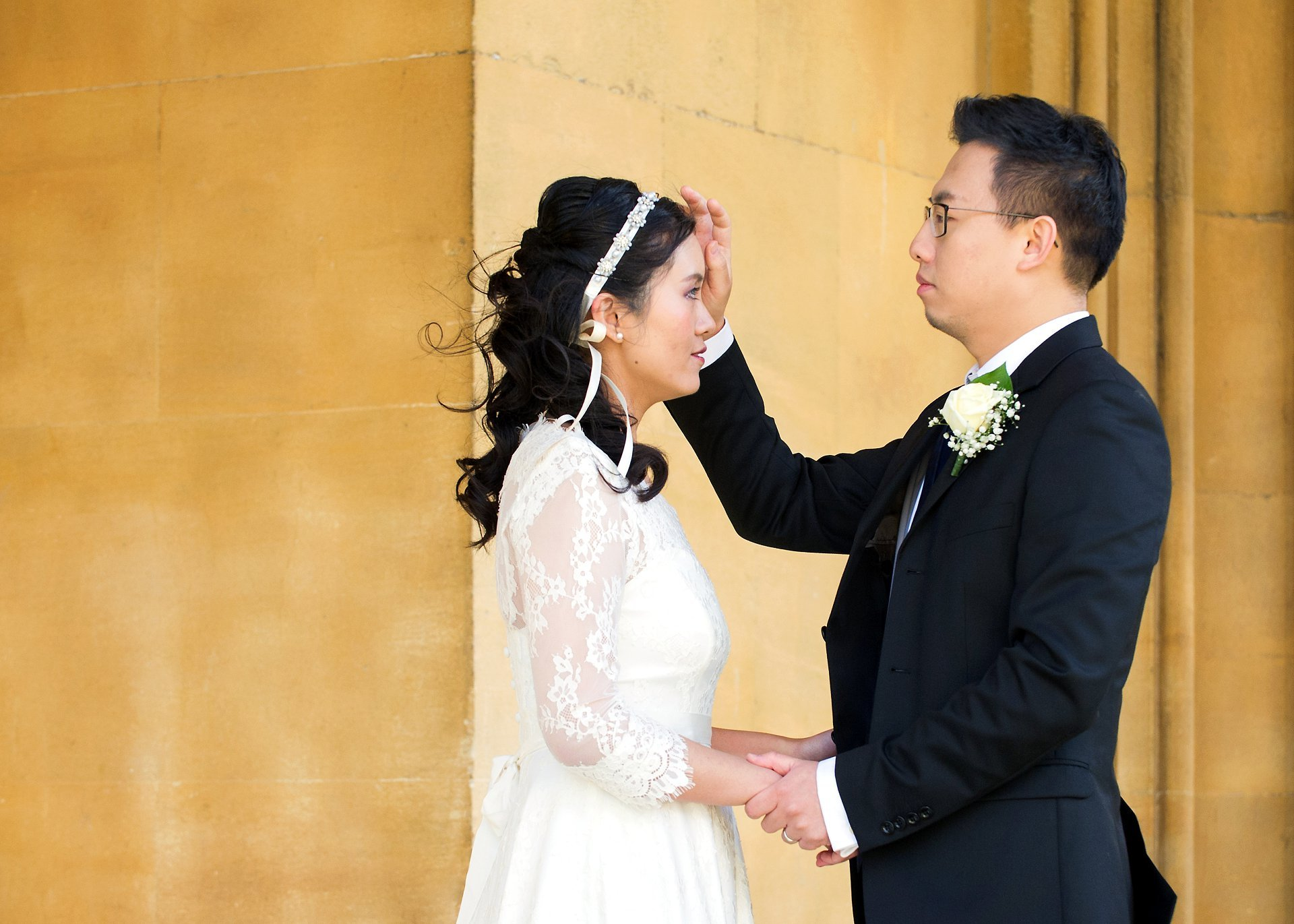 a chinese bride and groom after their chinese wedding in london at chelsea old town hall