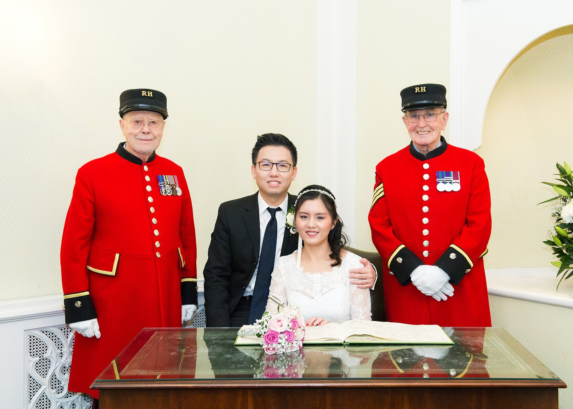 a chinese bride and groom and two chelsea pensioner witnesses at chelsea old town hall