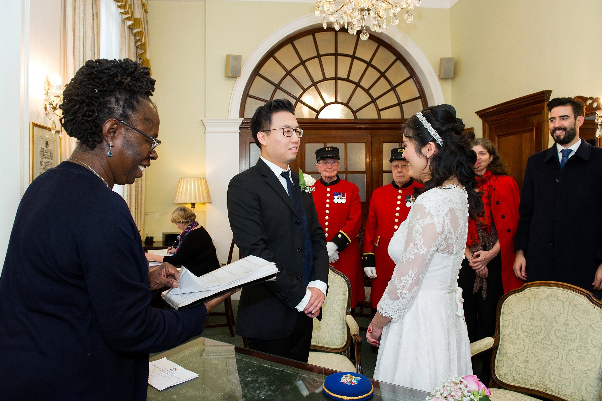 a chinese bride and groom say their vows captured by london register office photographer emma duggan