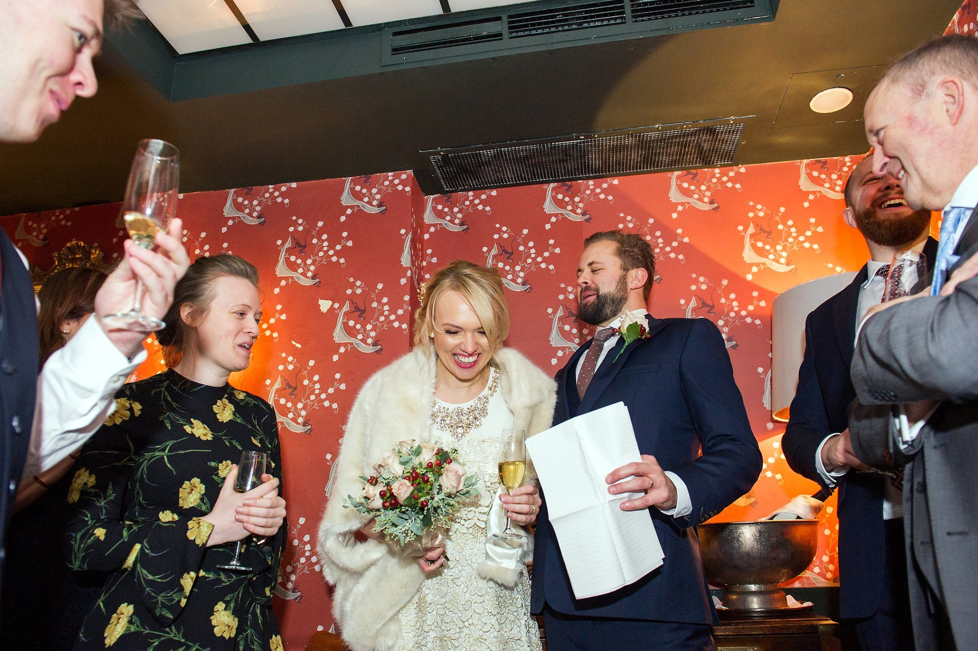 groom makes his bride and guests laugh during his speech at bocca di lupo
