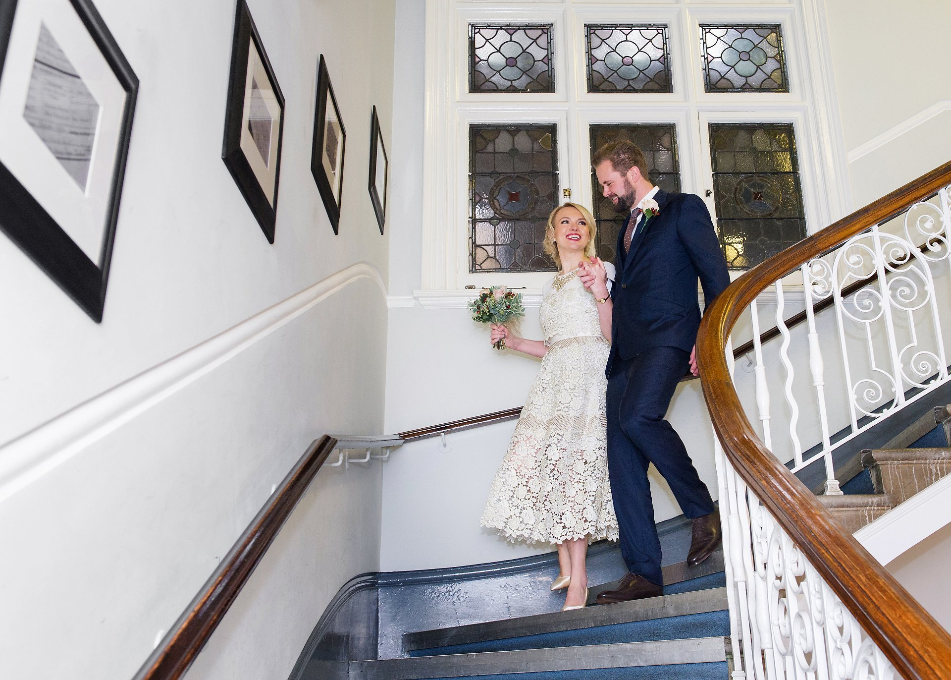 one of the last times a bride and groom will walk down the mayfair library staircase