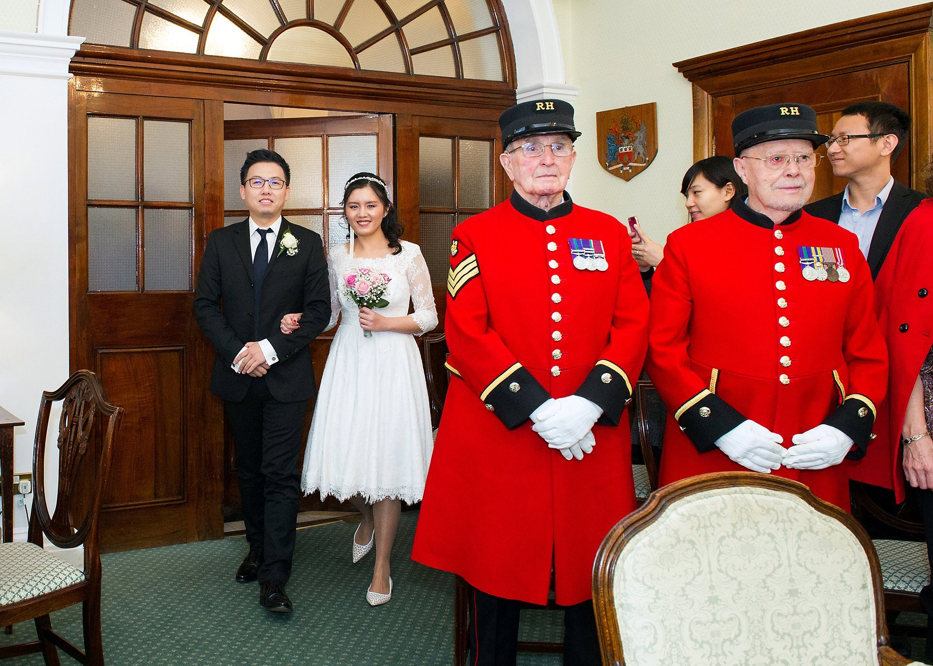 rossetti room ceremony in chelsea old town hall and a couple entering