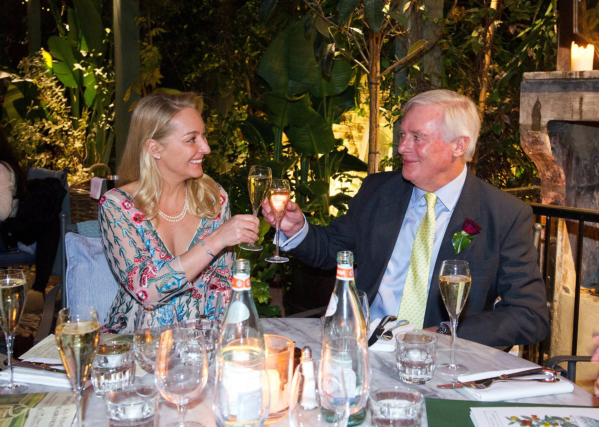 the ivy chelsea garden wedding photographer a recently married couple celebrate with champagne