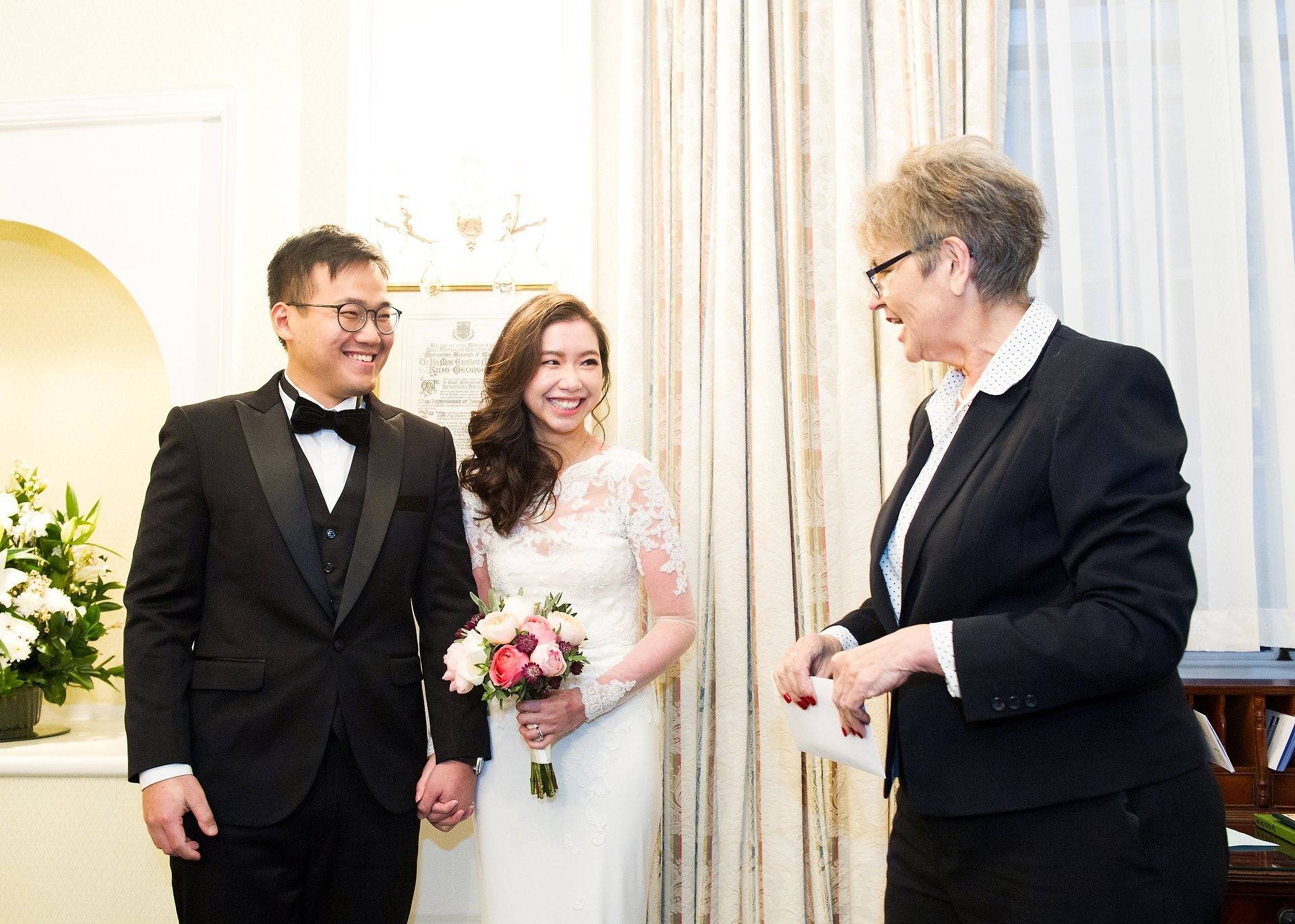 Bride and groom with registrar in Chelsea's Rossetti Room