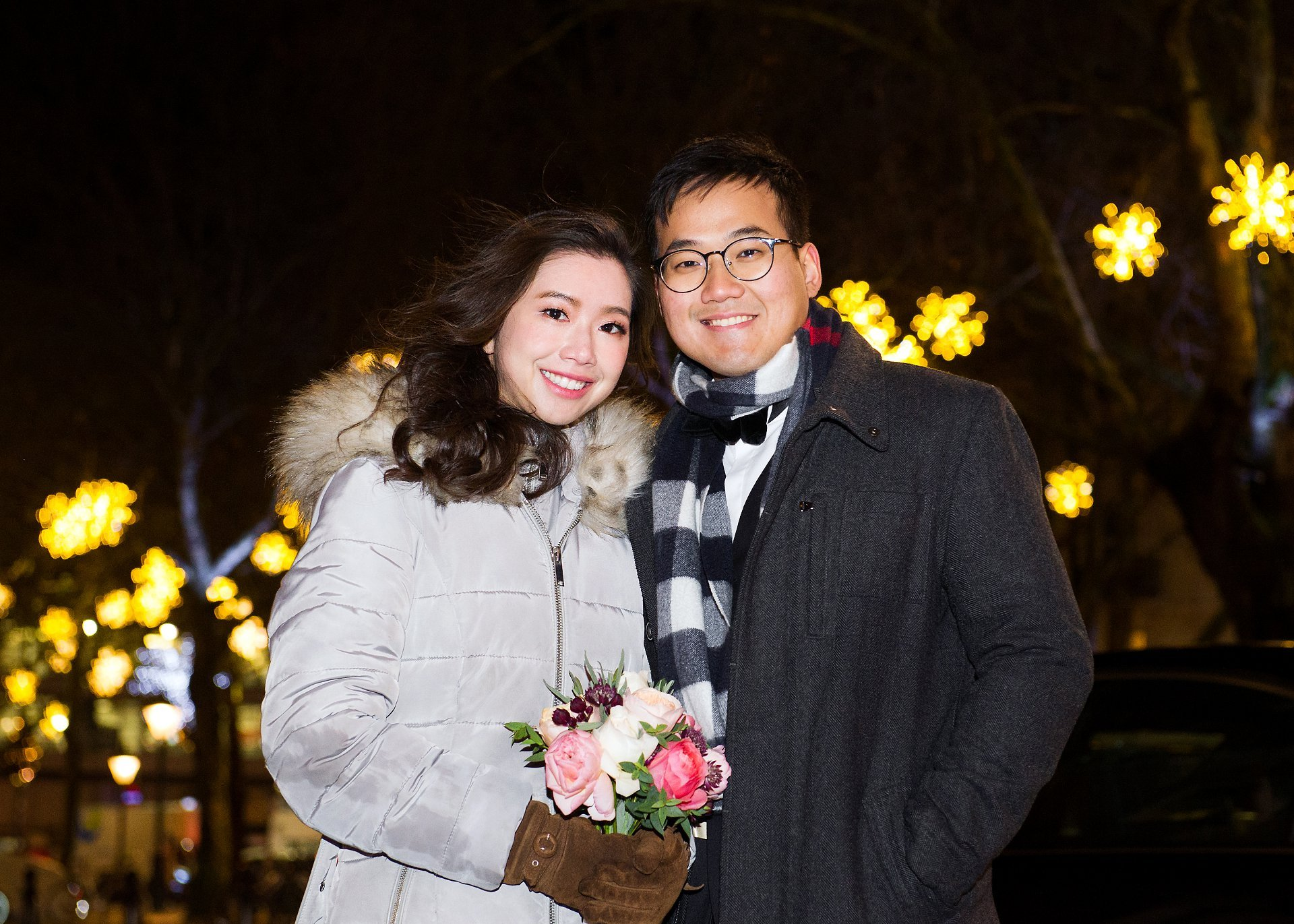 Chelsea Old Town Hall Christmas wedding bride and groom in Sloane Square with Christmas lights