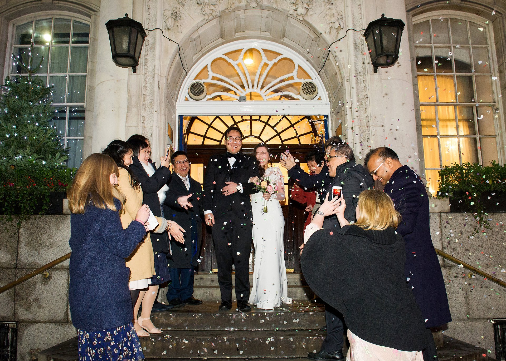 Chelsea Old Town Hall Christmas wedding bride and groom leaving Chelsea Register Office and confetti on the famous steps