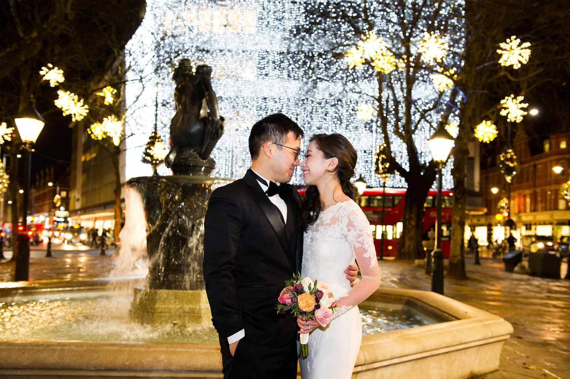 Chelsea Old Town Hall Christmas wedding bride and groom in Sloane Square with fountain and Peter Jones Christmas lights