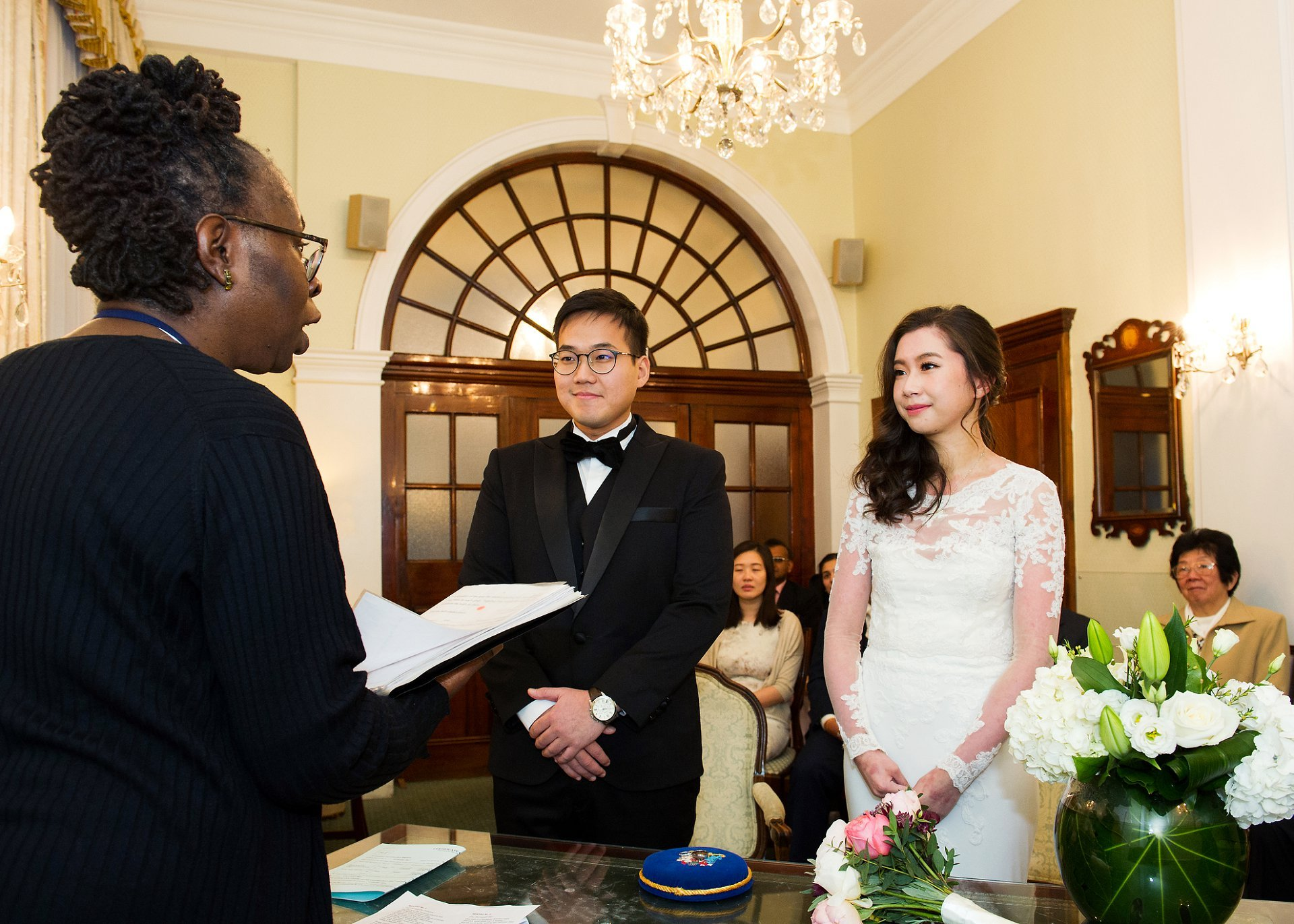 Chelsea Old Town Hall wedding photographer and bride and groom saying their rossetti room vows
