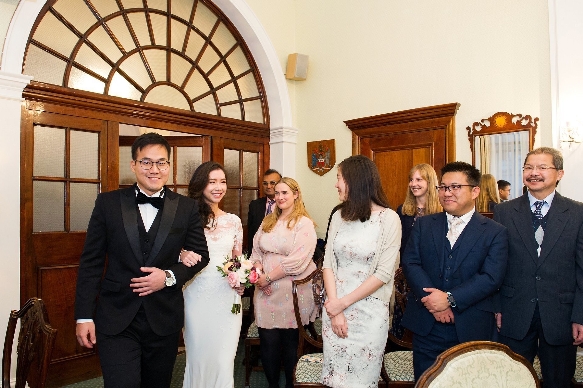 Chelsea Old Town Hall wedding photography bride and groom enter Rossetti Roomat the start of their ceremony