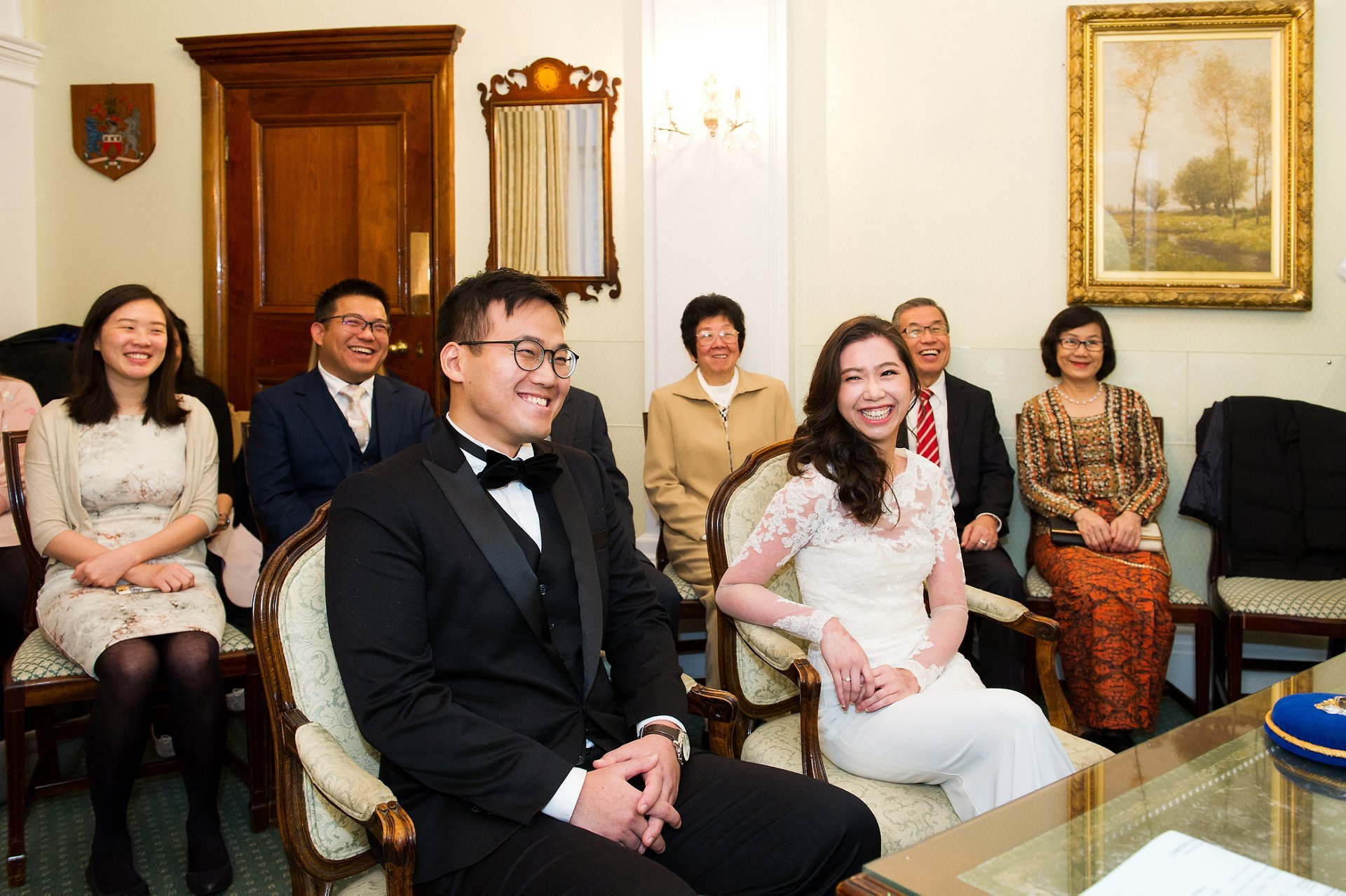 Chelsea Register Office wedding photography bride and groom laughing at start of civil ceremony Rossetti Room