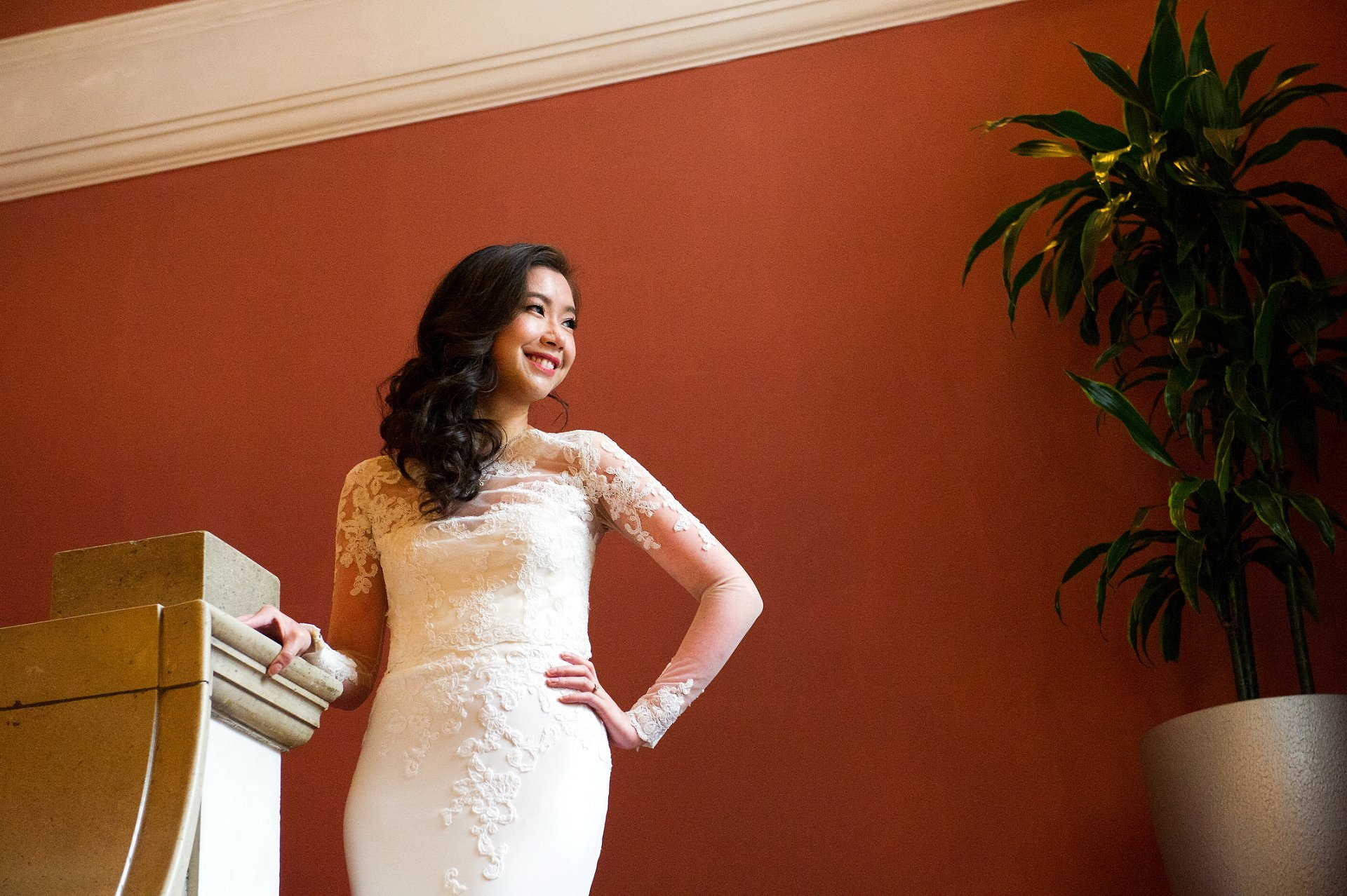 Chelsea Register Office wedding photography bride on staircase looking out of window