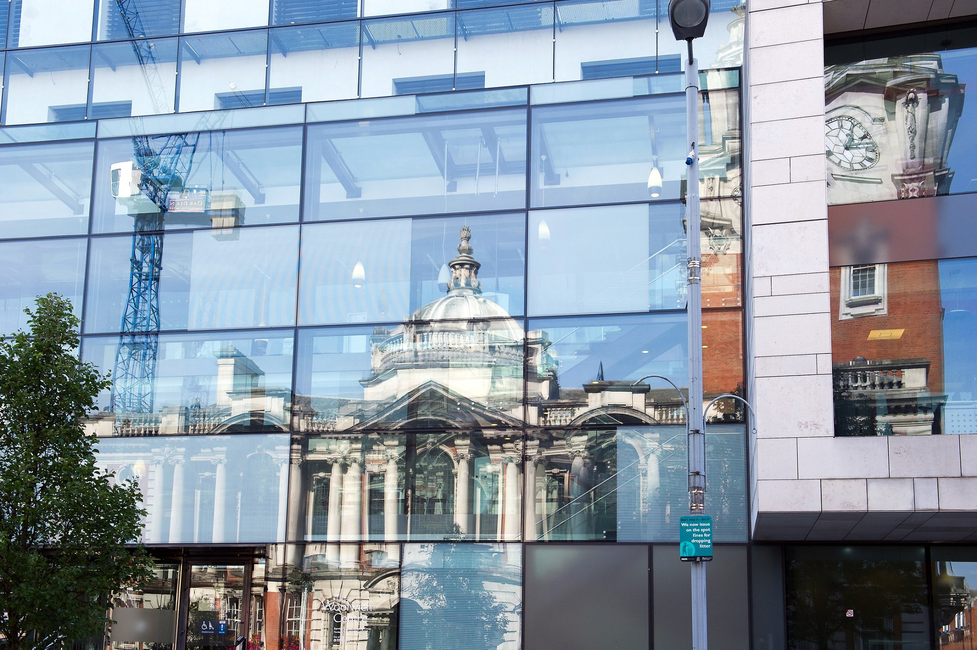 Exterior Greenwich Register Office is at Woolwich Town Hall and here is shown reflected in the windows opposite