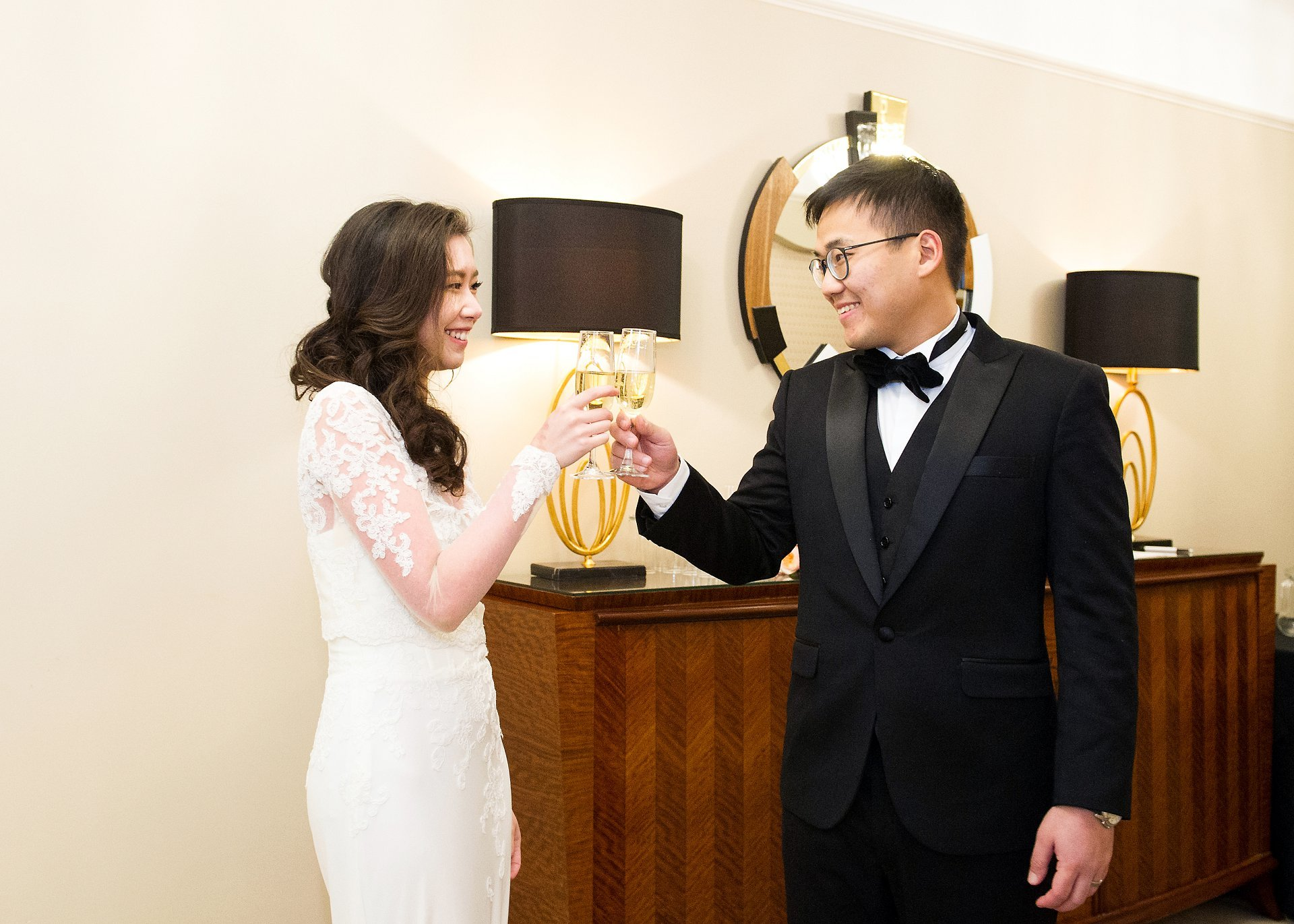 Lansdowne Club wedding reception bride and groom toast with champagne in private dining room