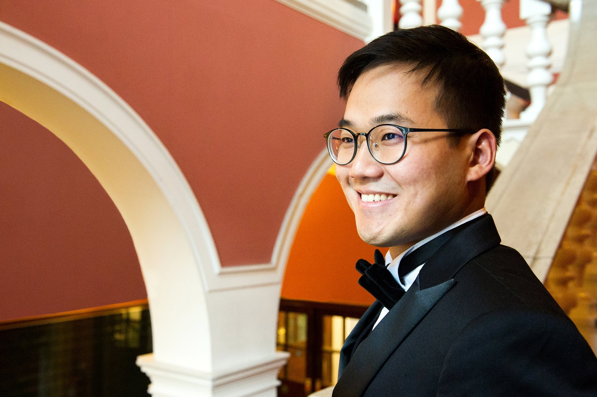 Malaysian wedding Chelsea Old Town Hall groom on staircase before ceremony in the Rossetti Room