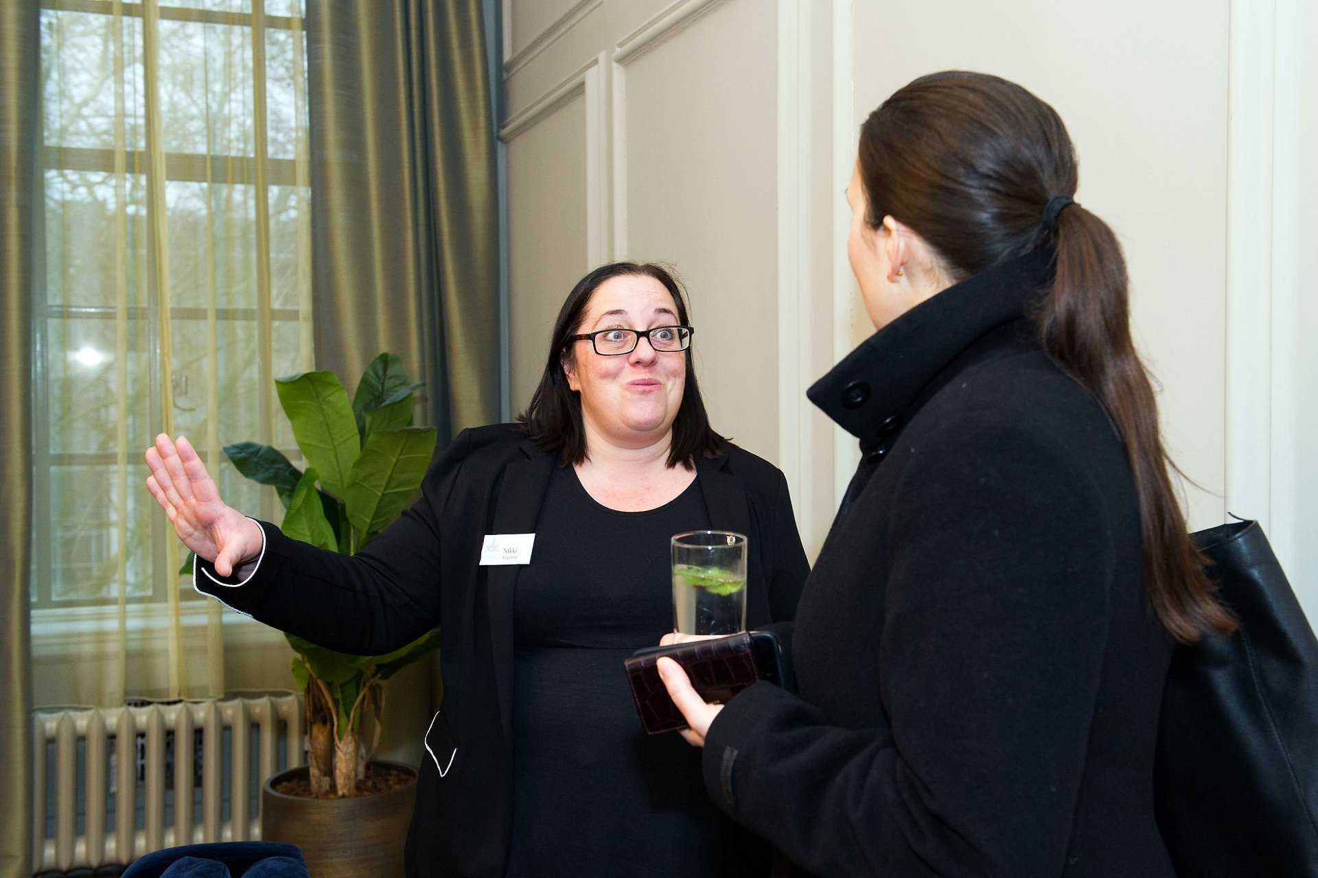 Nikki, a Westminster Register Office Registrar talks to a visitor to the Old Marylebone Town Hall opening event