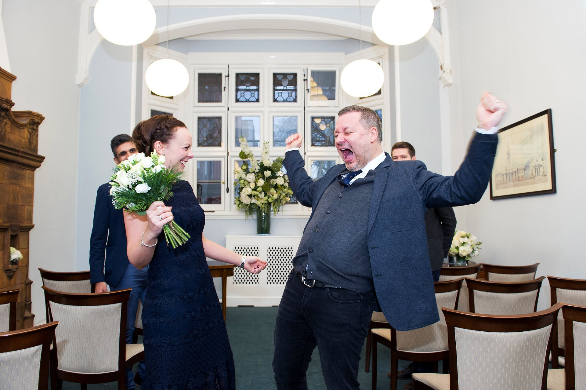 a groom celebrates his marriage captured by register office wedding photographer emma duggan