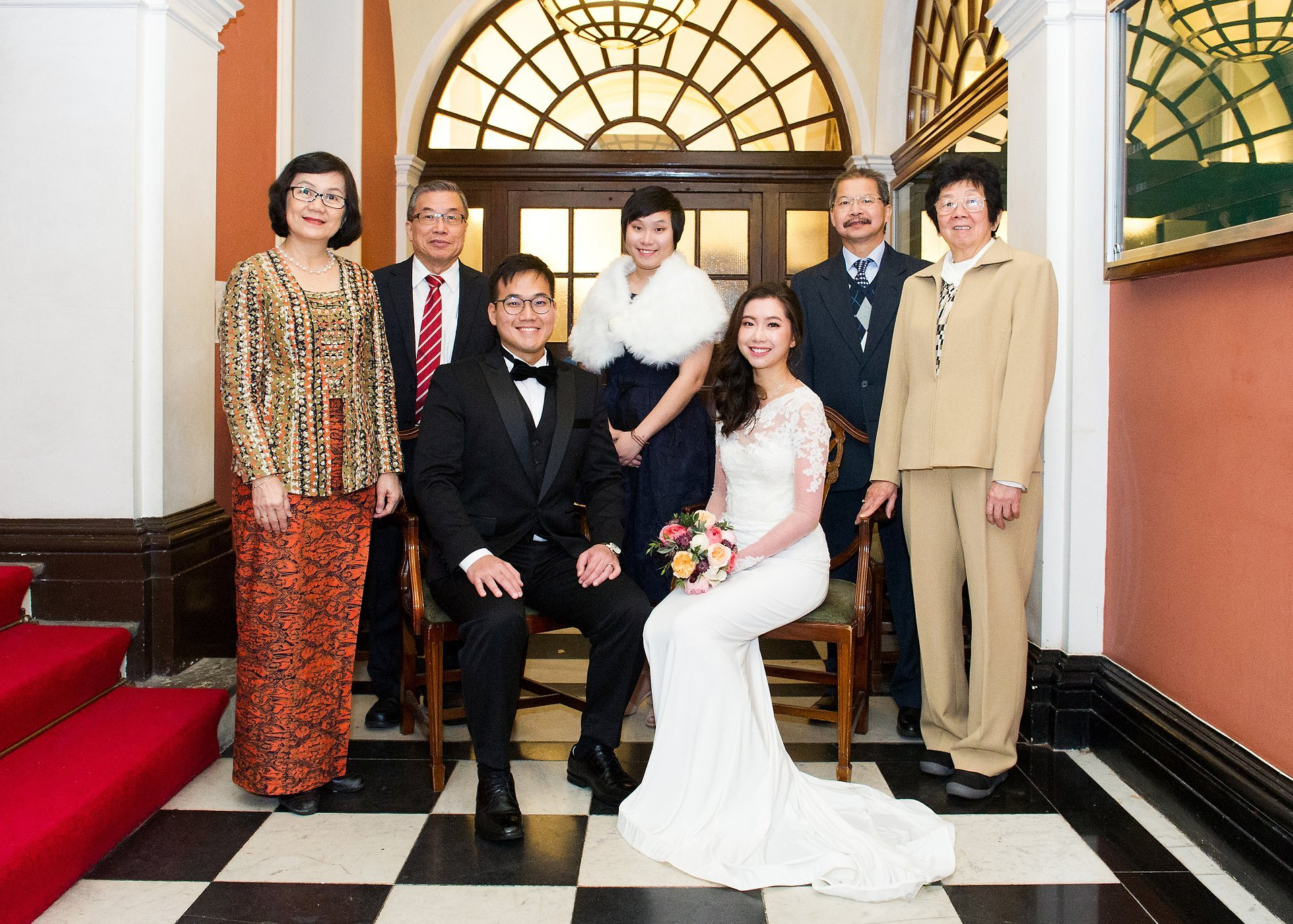 Rossetti Room Christmas wedding group photographs in waiting area due to cold and rain