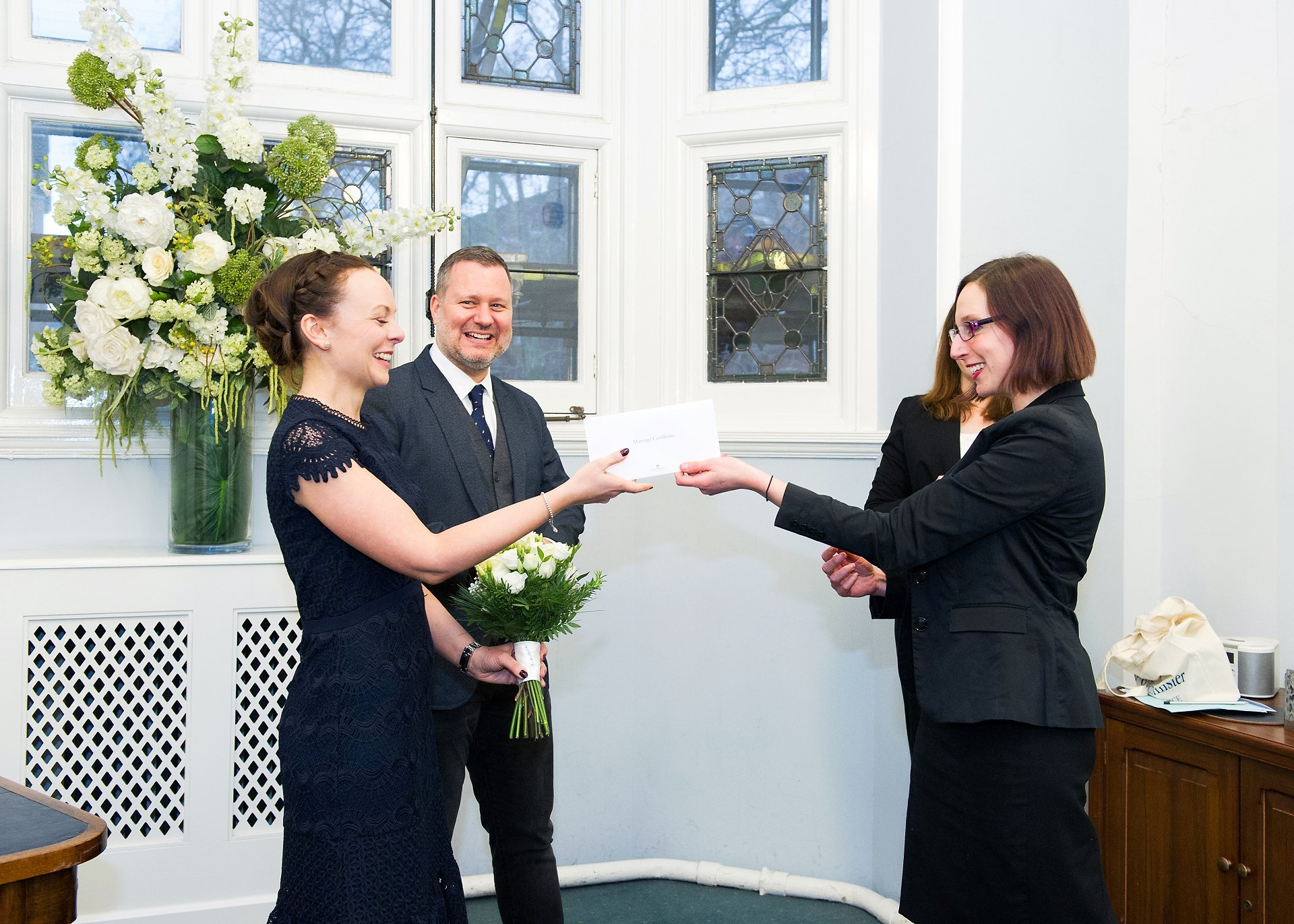 the registrar hands over the wedding certificate at this westminster wedding