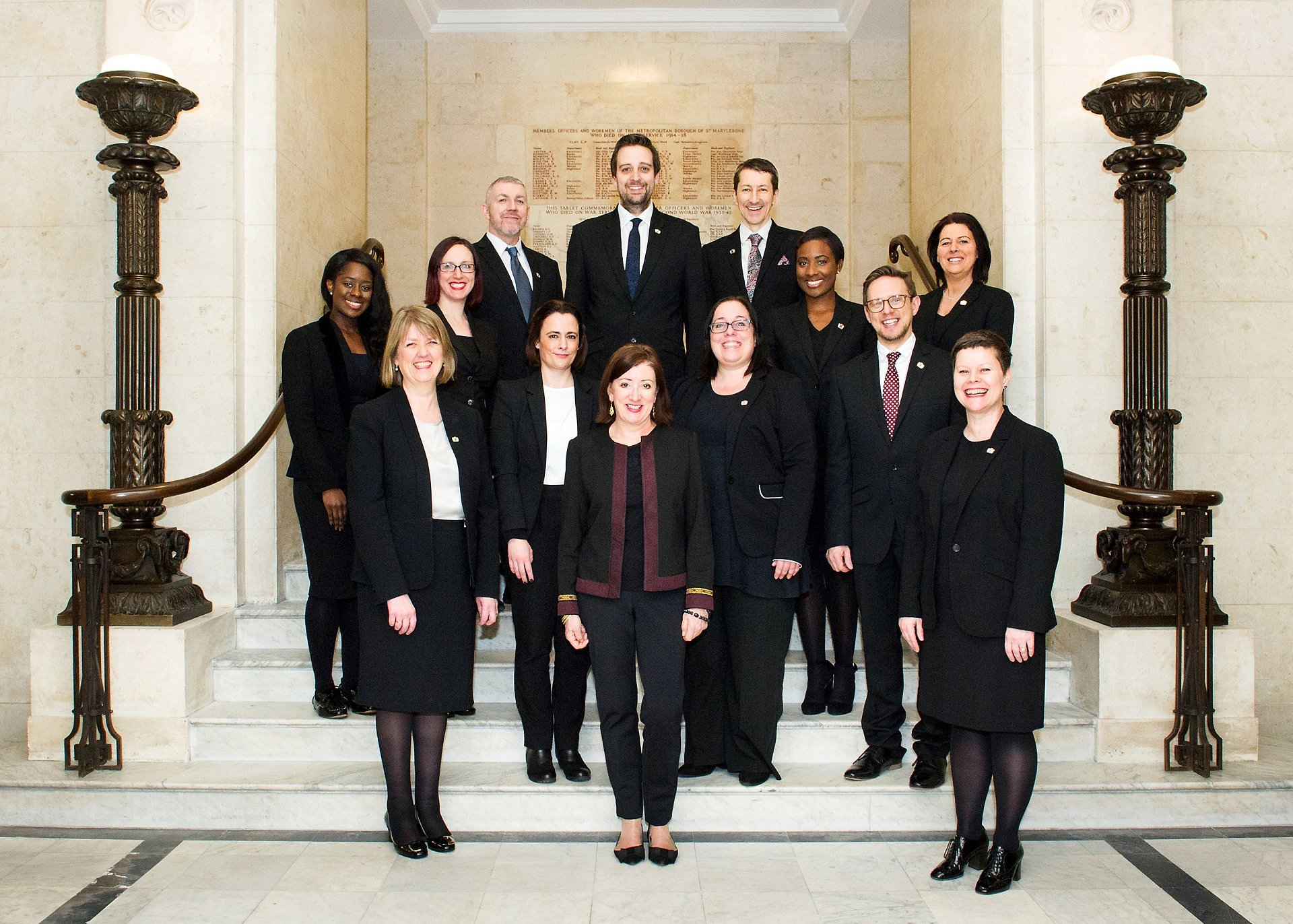 Westminster Register Office Registrars on the main staircase at Old Marylebone Town Hall by Emma Duggan Photography, a specialist register office wedding photographer