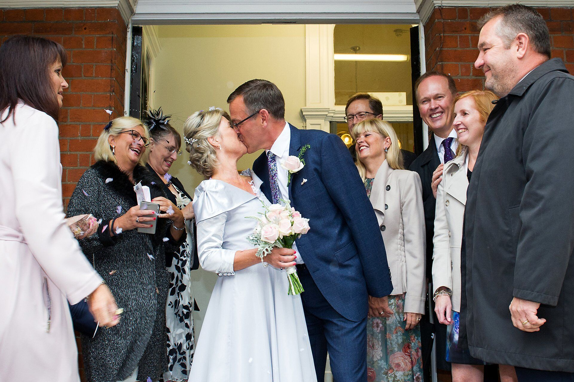 confetti in the rain by westminster registry office wedding photographer emma duggan