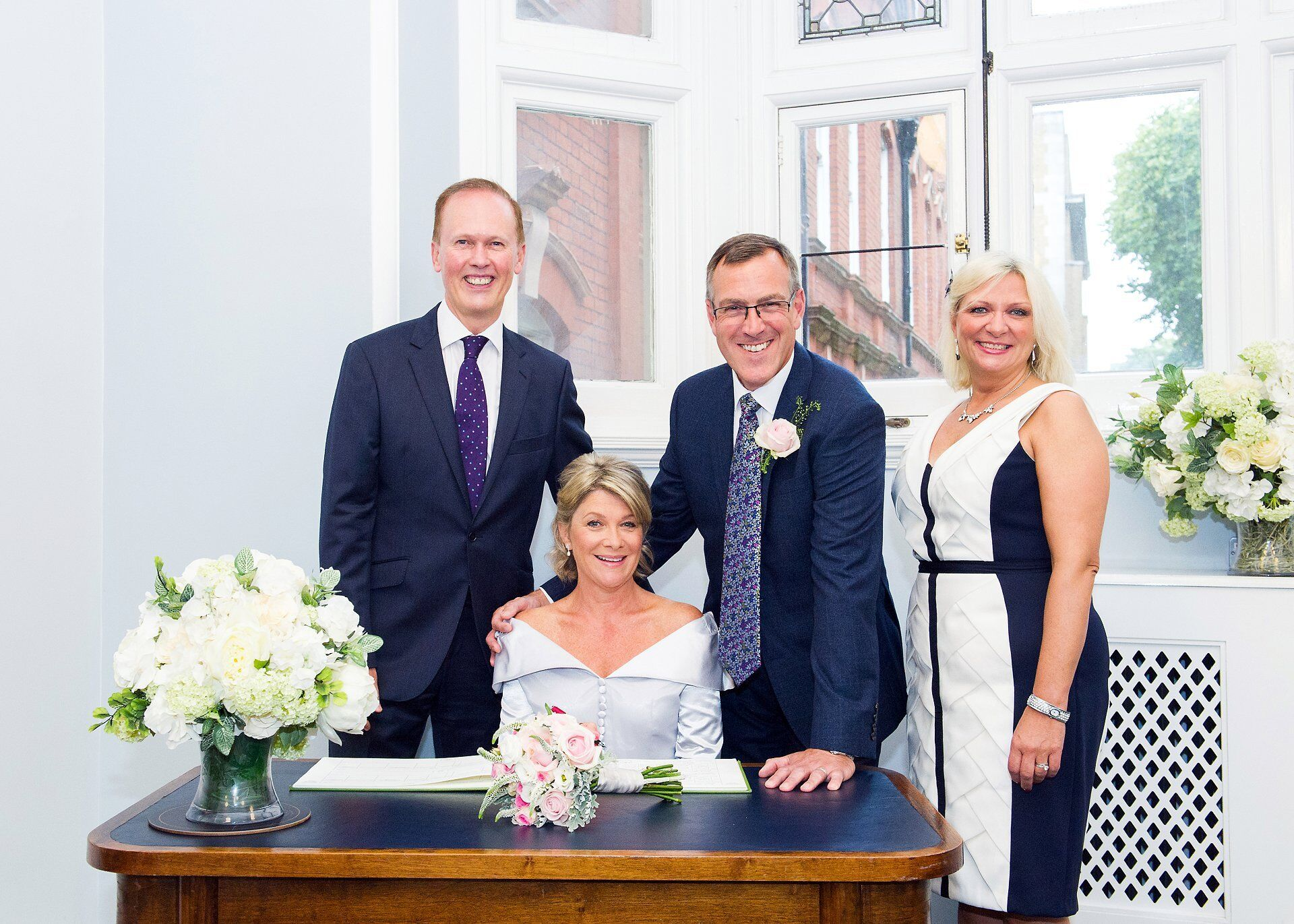 couple and their two witnessess at mayfair library wedding photography by emma duggan