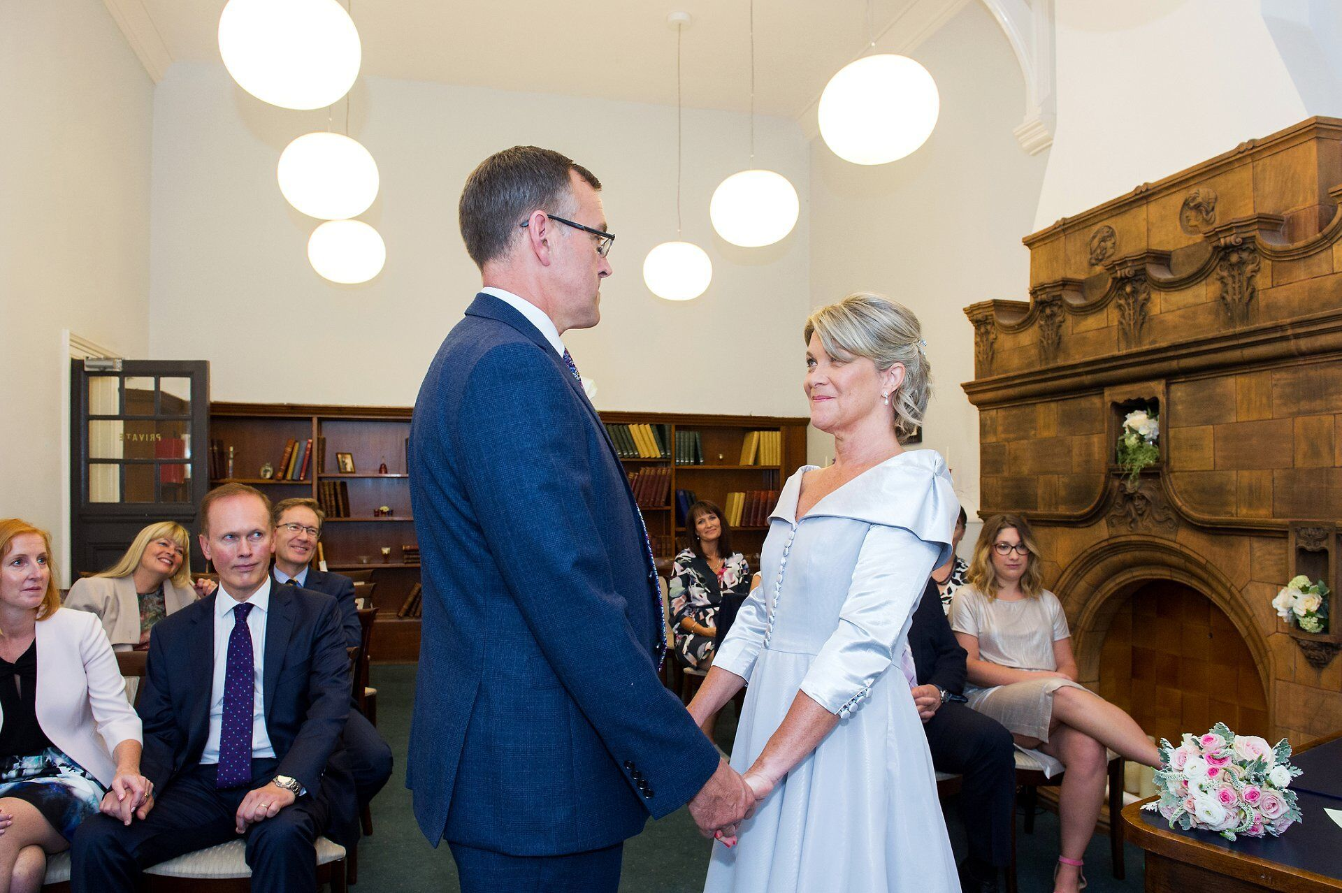exchange of vows during this marylebone room ceremony at mayfair library