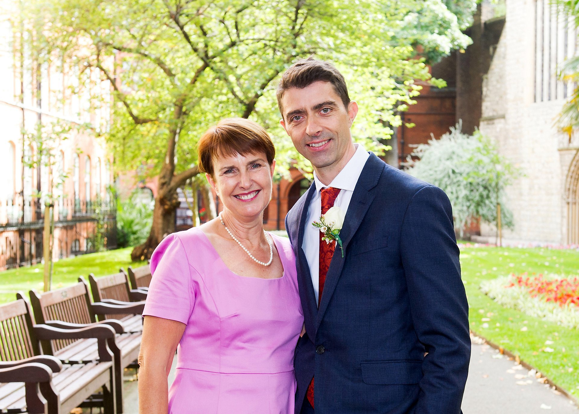 groom and his mother in mount street gardens with mayfair wedding photography by emma duggan
